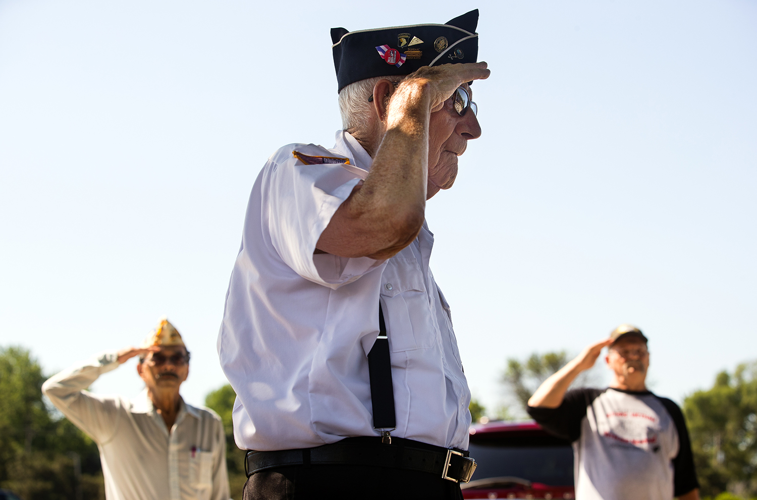 Korean War Army veteran Wendell Koke salutes as Gold Star Mother Phillipa Porter sings the National Anthem during Memorial Day ceremony at Oak Ridge Cemetery Monday, May 28. [Ted Schurter/The State Journal-Register]