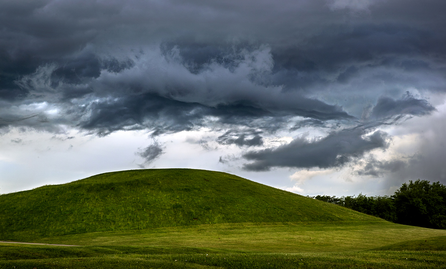 A system of dark, rain-bearing clouds move north east above the hill at Centennial Park Thursday, June 21, 2018. Nearly three quarters of an inch of rain fell before the sun set at 8:30 p.m. on the summer solstice, the shortest night of the year in the Northern Hemisphere. [Ted Schurter/The State Journal-Register]