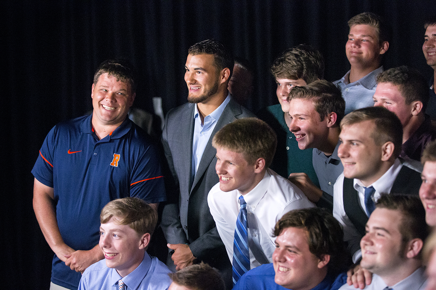 The Chicago Bears quarterback Mitch Trubrisky, center, jumped in with the Rochester High School football team for a group picture after the Rockets were named for a second year as The State Journal-Register's 2018 Best of Capital Region Preps Team of the Year during an awards ceremony and banquet Friday,June 22, 2018 at the Bank of Springfield Center in Springfield, Ill. Rochester Head Coach Derek Leonard is at left.  [Rich Saal/The State Journal-Register]