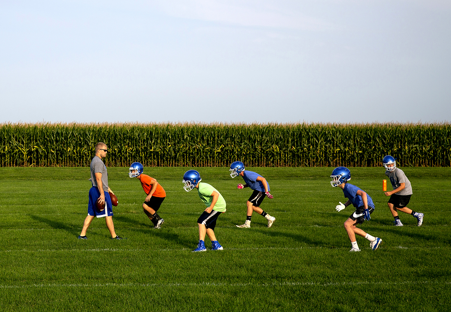 The Auburn High School football team runs through drills on the first day of team practice permitted by the Illinois High School Association Monday, Aug. 6, 2018 at Auburn High School in Auburn, Ill.[Rich Saal/The State Journal-Register]