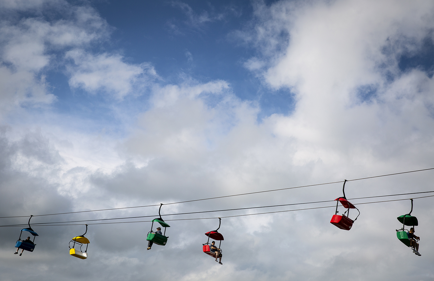 Chairs on the Sky Glide float above the Illinois State Fairgrounds Wednesday, Aug. 15, 2018 during the Illinois State Fair in Springfield, Ill. [Rich Saal/The State Journal-Register]