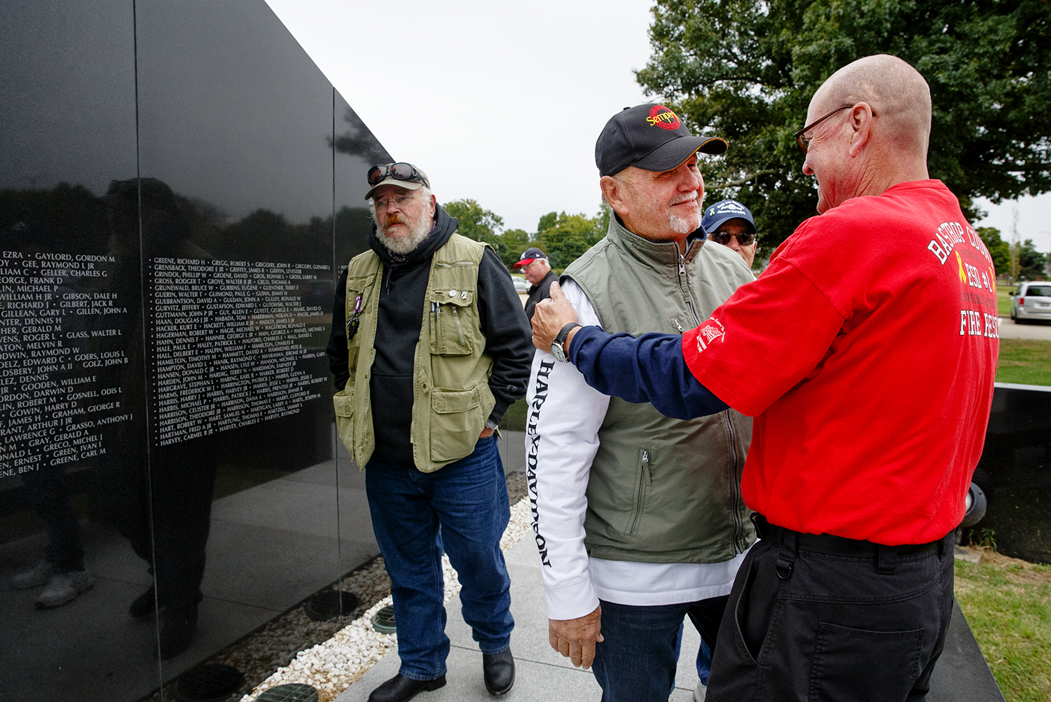 Mark Clingan, right, greets Tim Dunham during a gathering of the Springfield High Class of 1968 who were Vietnam veterans gathered to catch up and reminisce at the Vietnam War Memorial in Oak Ridge Cemetery Saturday, Sept. 29, 2018. [Ted Schurter/The State Journal-Register]