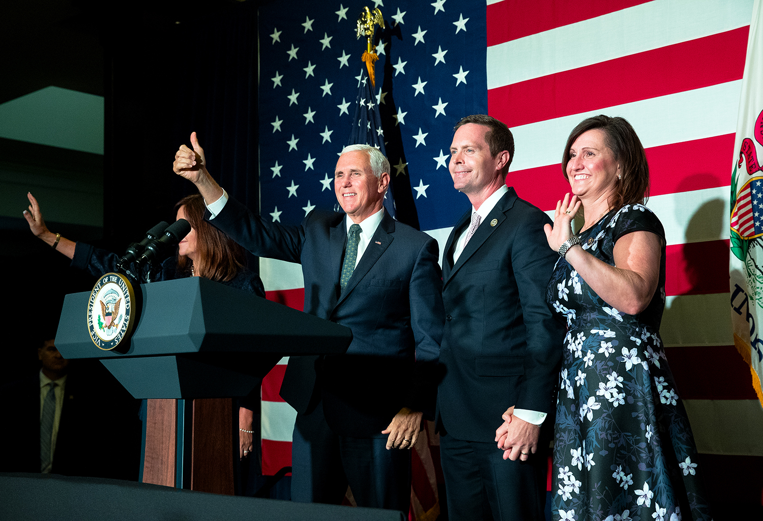 Karen and Vice President Mike Pence, left, and Rodney Davis, R-Taylorville, and his wife Shannon wave to the crowd gathered at Panther Creek Country Club in Springfield, Ill., Friday, Oct. 12, 2018. Davis is locked in a nationally watched race for the 13th Congressional District against Democrat Betsy Dirksen Londrigan of Springfield. [Ted Schurter/The State Journal-Register]