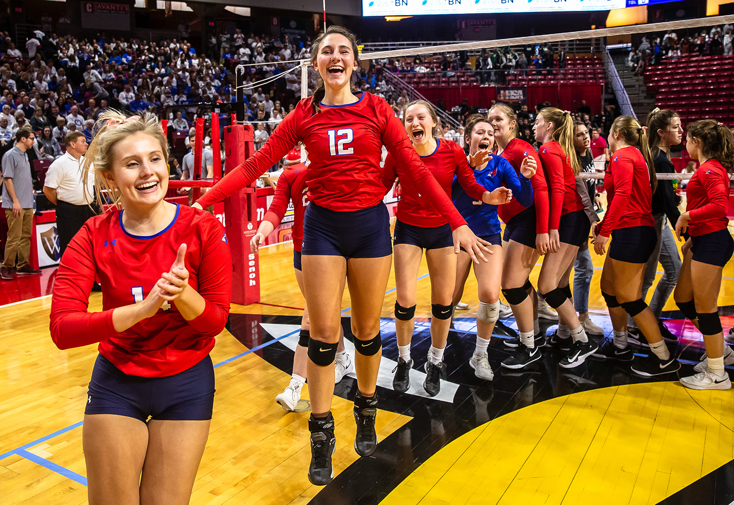 Pleasant Plains' Maddie Reiser (12) and the Cardinals celebrate their victory over Champaign St. Thomas More during the Class 2A IHSA Volleyball State Final Tournament semifinals at Redbird Arena, Friday, Nov. 9, 2018, in Normal, Ill. [Justin L. Fowler/The State Journal-Register]