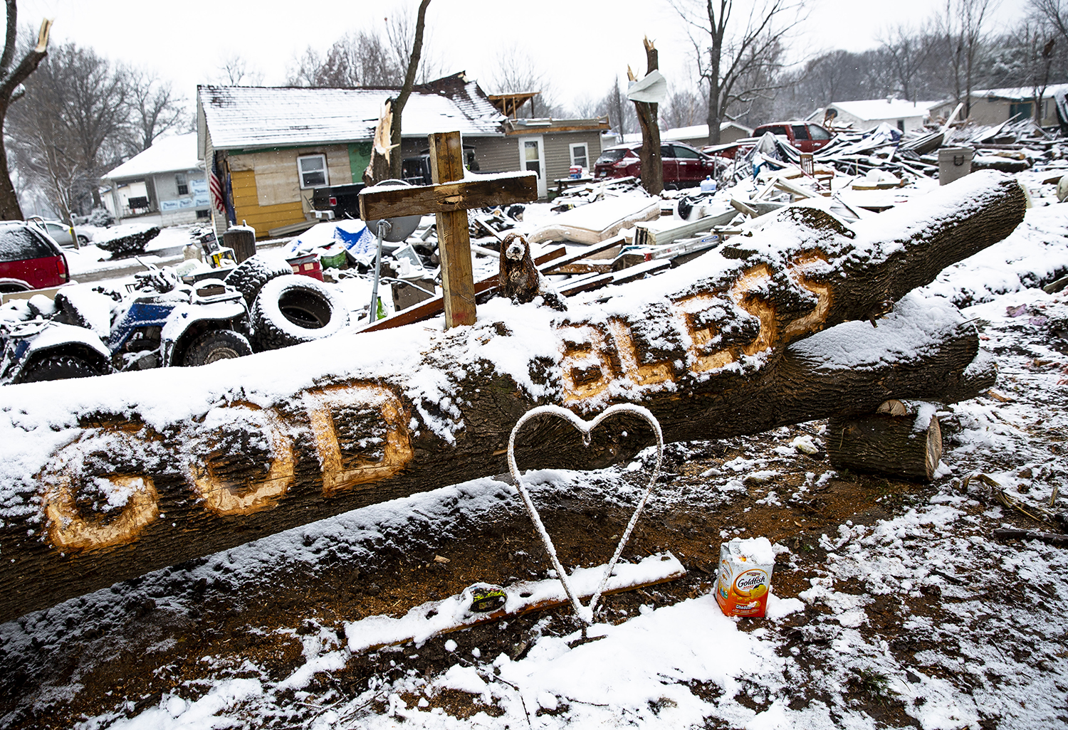 Steven Tirpak carved an uplifting message in a tree felled by the tornado that destroyed his home on Coal Street in Taylorville on Saturday. The tree was photographed Thursday, Dec. 6, 2018 on Coal Street Taylorville, Ill. [Rich Saal/The State Journal-Register]