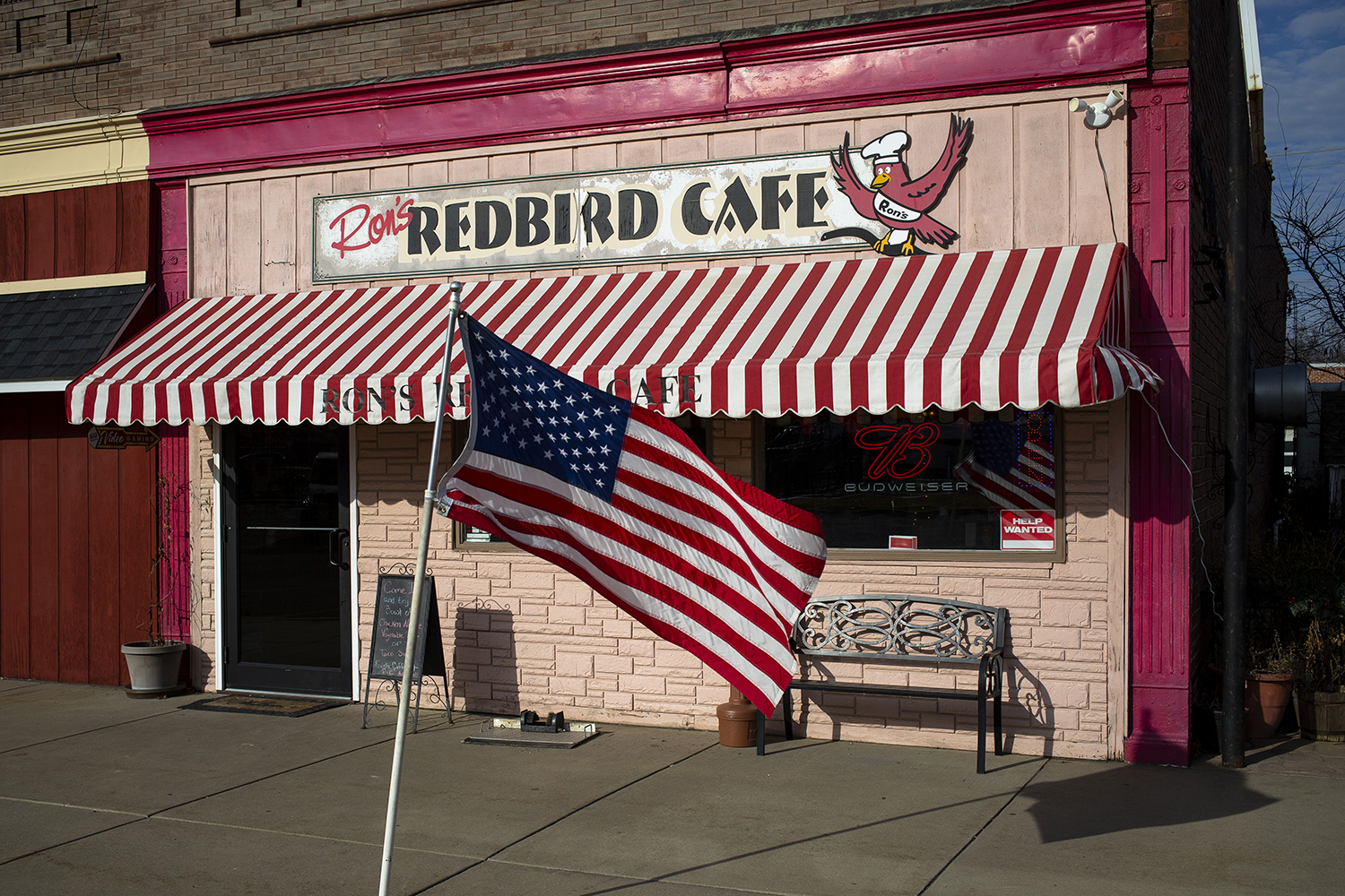 The Stars and Stripes fly in front of Ron's Redbird Cafe in Girard, Dec. 19, 2018. [Rich Saal/The State Journal-Register]