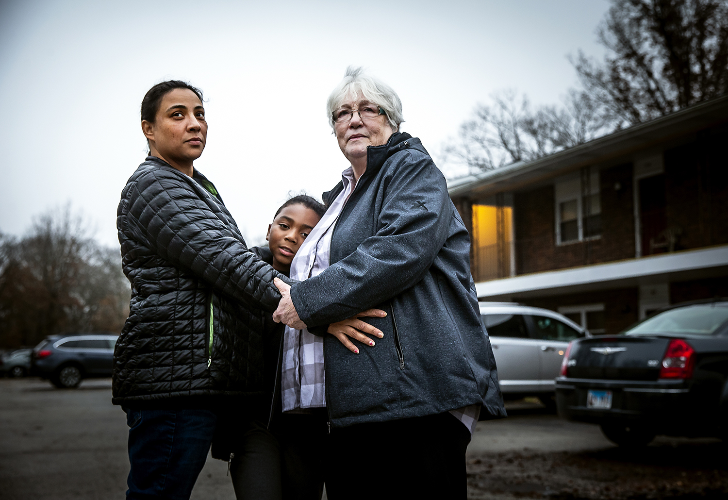 Tiffani Bailey, left, her son Isaiah Barbour Smith, center, and her mother, Diana Denning, right, held each other tightly as they survived the tornado that destroyed their home in Hewittville, an unincorporated village south of Taylorville, Ill. Their neighbor watched from a concrete shelter as the tornado picked up their home and sent in tumbling as it was destroyed. [Justin L. Fowler/The State Journal-Register]