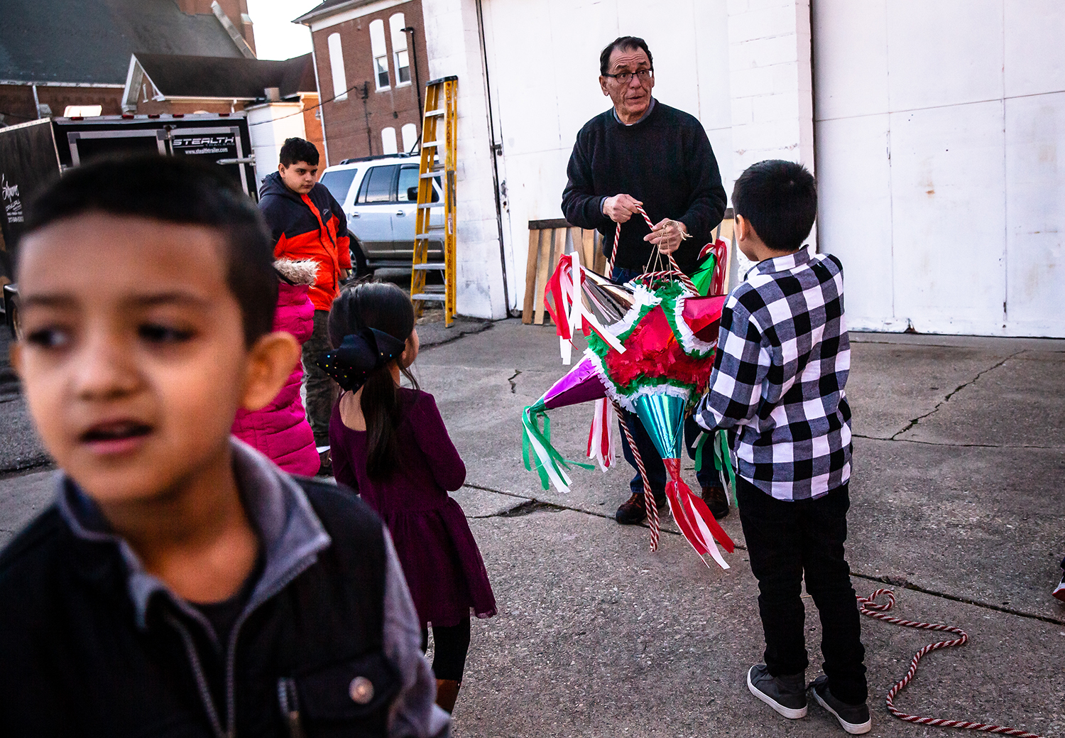 "Edward Cardenas prepares a piñata filled with candy for the children to take swings at during the Las Posadas celebration at the St. Katharine Drexel Parish, Saturday, Dec. 15, 2018, in Springfield, Ill. The piñata represents children conquering ""evil"" with each horn representing one of the seven deadly sins. [Justin L. Fowler/The State Journal-Register]"