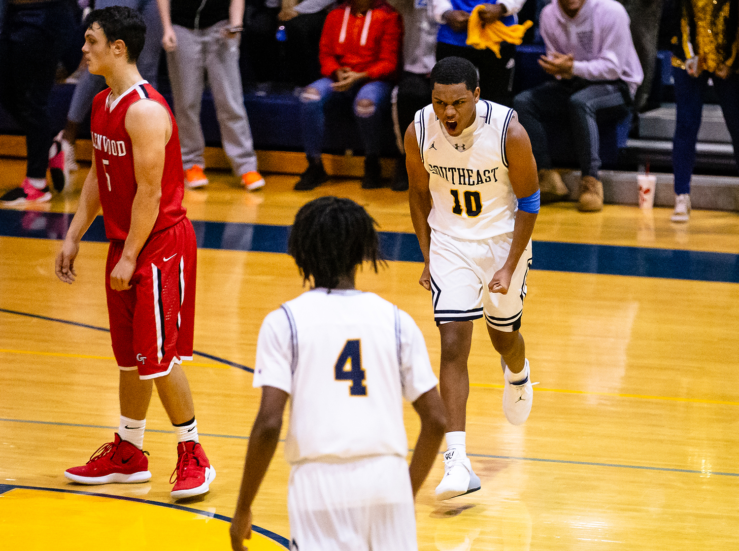 Southeast's Damon Davis (10) reacts after draining a 3-pointer against Glenwood after the Spartans held a possession for over two minutes in the second half at Scheffler Gymnasium, Saturday, Dec. 15, 2018, in Springfield, Ill. [Justin L. Fowler/The State Journal-Register]