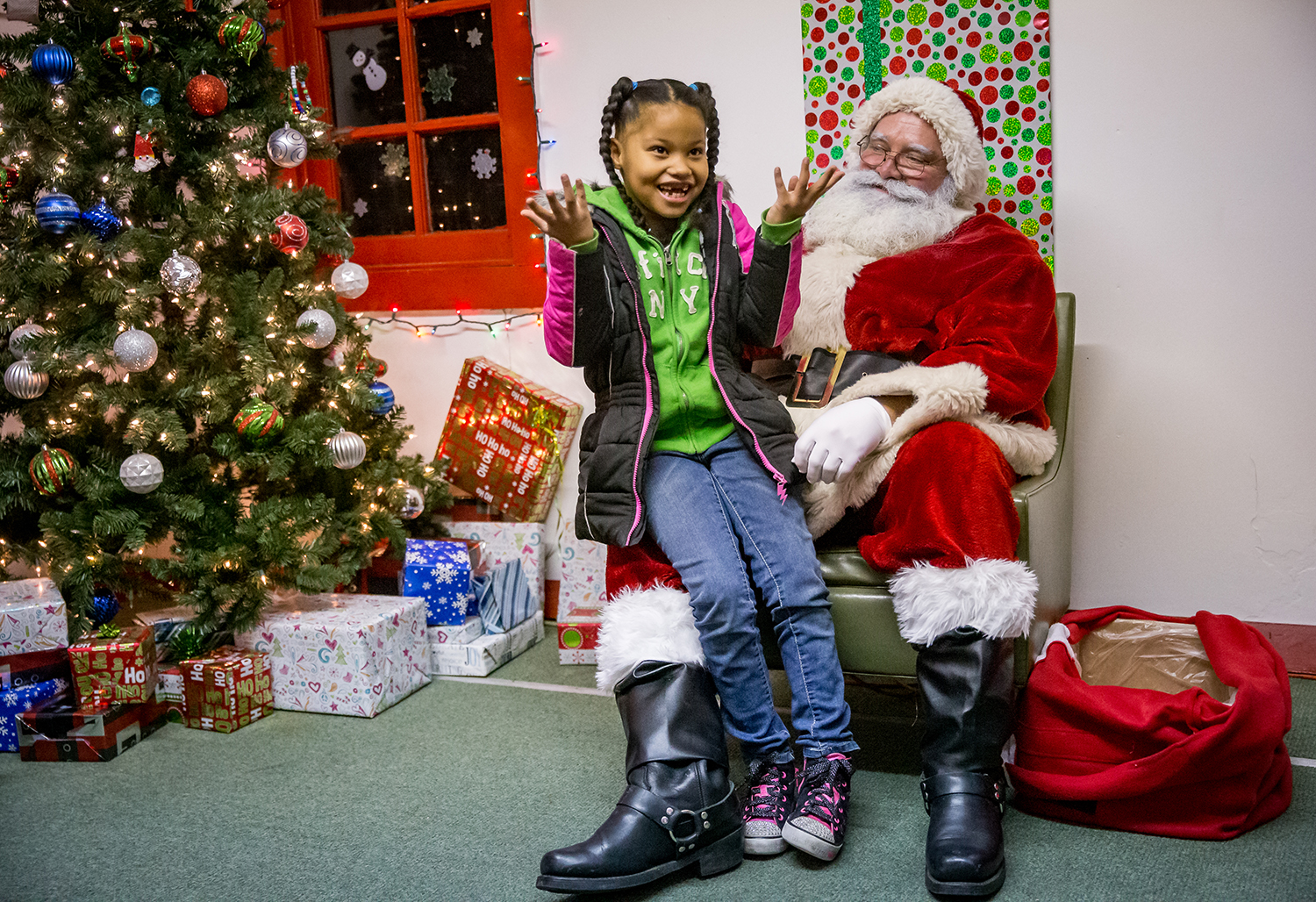 Jaedyn Richards, 8, gets stumped while trying to recite the order of Santa's reindeer after telling Santa what she wanted for Christmas at the Springfield Park District's Santa House at Robin Roberts Stadium, Friday, Dec. 21, 2018, in Springfield, Ill. The last chance to see Santa before he leaves for the North Pole is on Saturday from 11 a.m. to 6 p.m. with admission being free. The Springfield Park District's Santa House, located next to Robin Roberts Stadium in Springfield, has been an area family tradition for decades.  [Justin L. Fowler/The State Journal-Register]