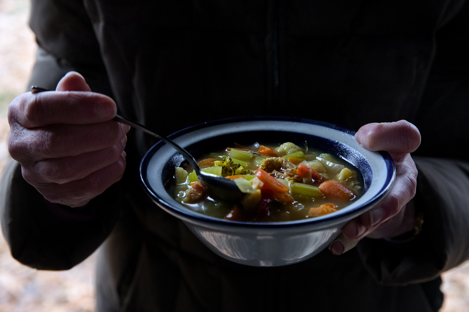 "Participants eat their ""stone soup"" during the Sierra Club's annual Stone Soup Hike at Lincoln Memorial Garden Tuesday, Jan. 1, 2019. Guests brought their own item to add to the soup before embarking on a hike while the soup cooked. [Ted Schurter/The State Journal-Register]"