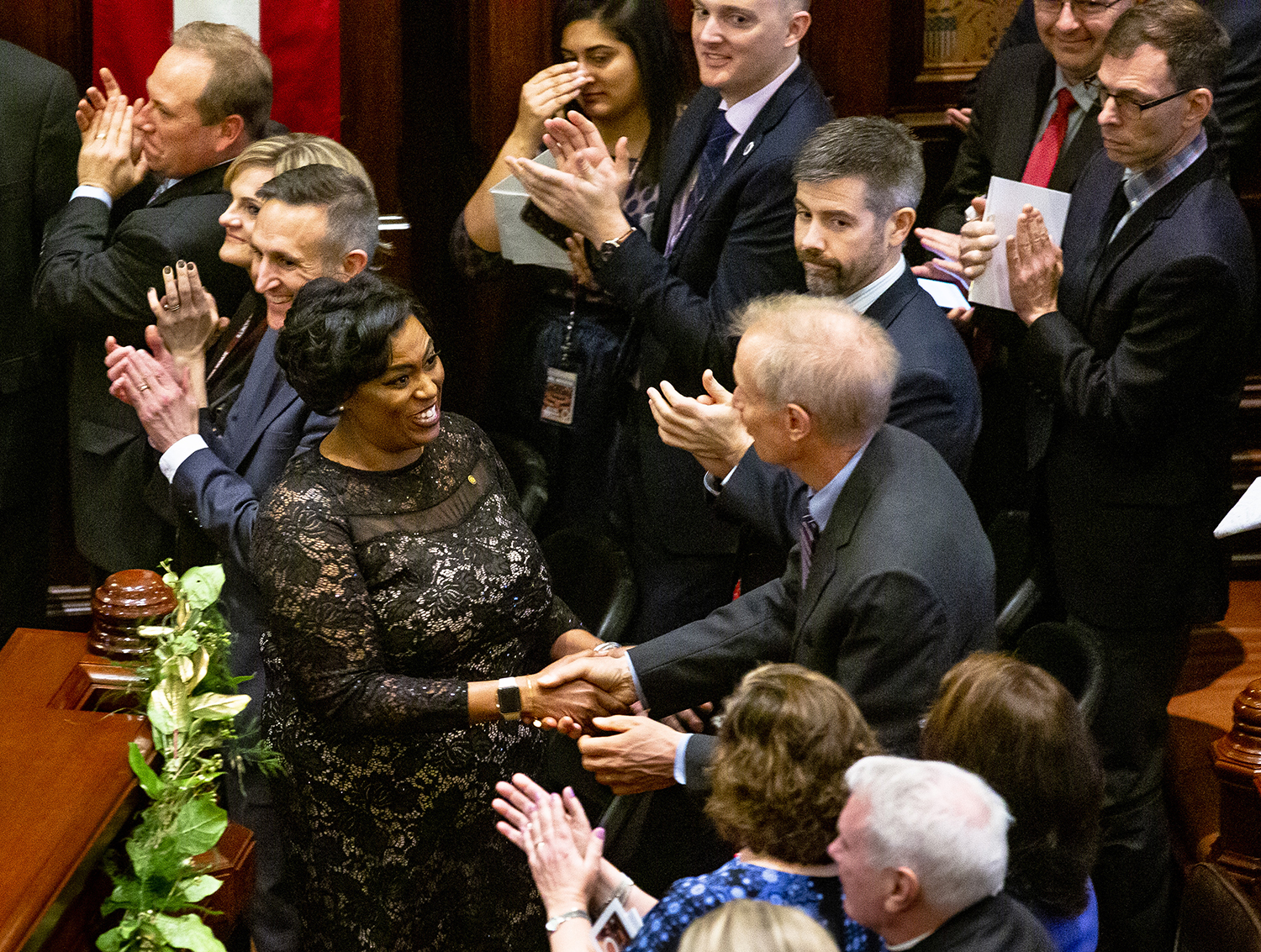 Tiffany Matthews greets Gov. Bruce Rauner after she presented a musical selection at the conclusion of the inauguration of the Illinois State Senate of the 101st General Assembly Wednesday, Jan. 9, 2019 at the Capitol in Springfield, Ill. [Rich Saal/The State Journal-Register]