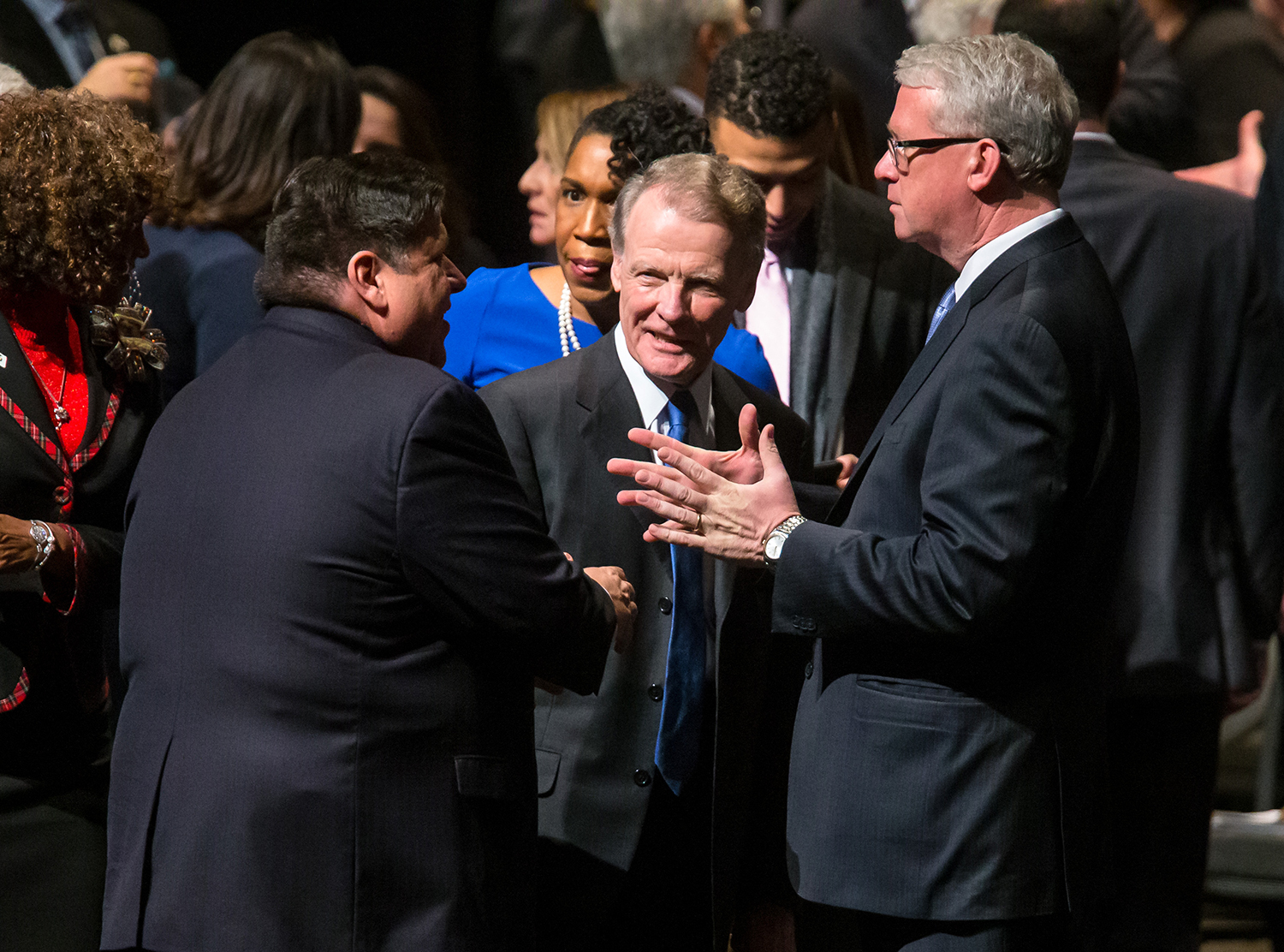 Illinois Speaker of the House Michael Madigan, D-Chicago, visits with Illinois House Minority Leader Jim Durkin, R-Western Springs, and Illinois Gov.-elect J.B. Pritzker prior to to the inauguration ceremony for the Illinois House of Representatives for the 101st General Assembly at the University of Illinois Springfield's Sangamon Auditorium, Wednesday, Jan. 9, 2019, in Springfield, Ill. [Justin L. Fowler/The State Journal-Register]
