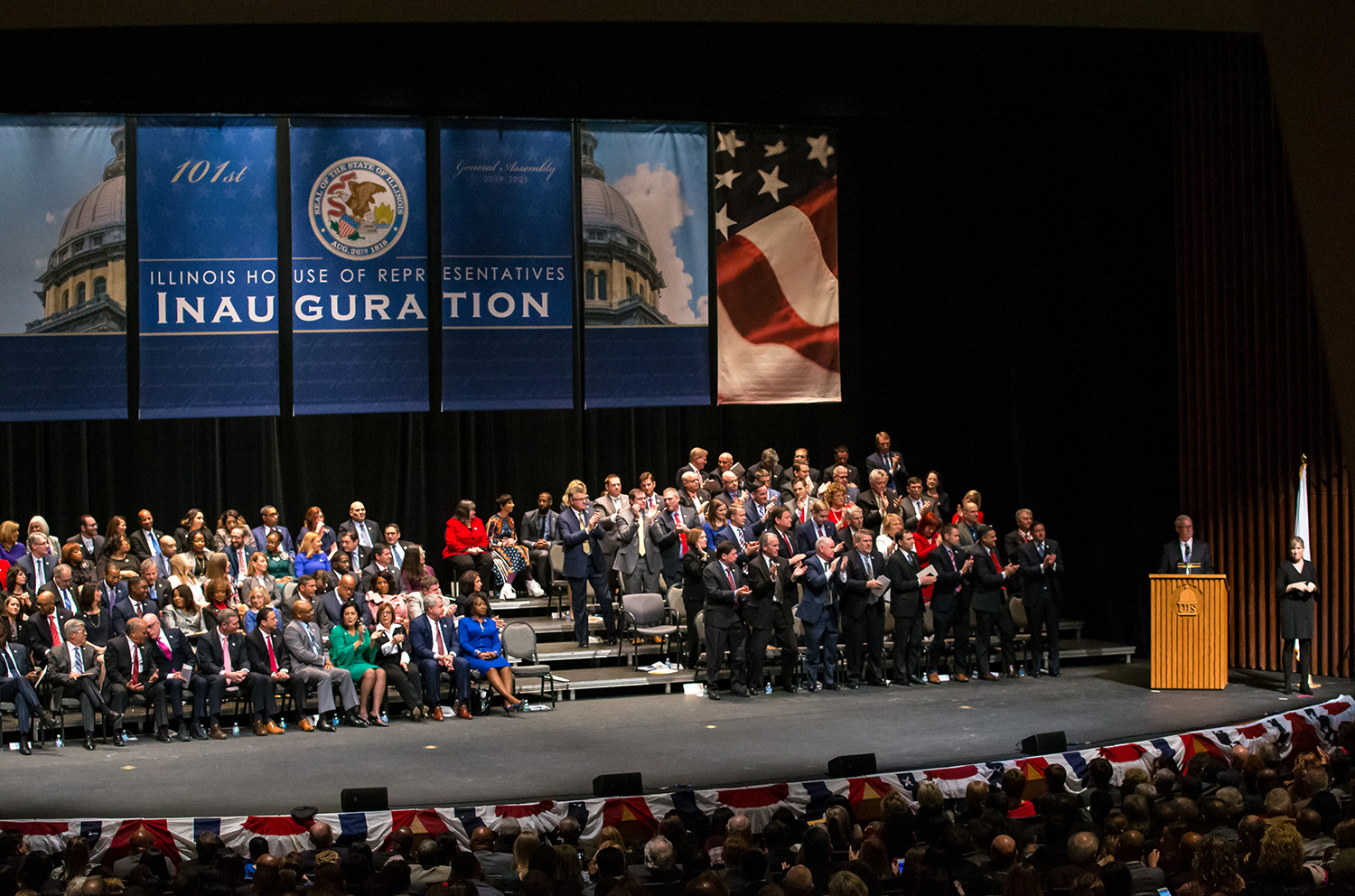 The Republican side of the aisle stand after Illinois House Minority Leader Jim Durkin, R-Western Springs, calls for non-partisan fair maps during the inauguration ceremony for the Illinois House of Representatives for the 101st General Assembly at the University of Illinois Springfield's Sangamon Auditorium, Wednesday, Jan. 9, 2019, in Springfield, Ill. [Justin L. Fowler/The State Journal-Register]