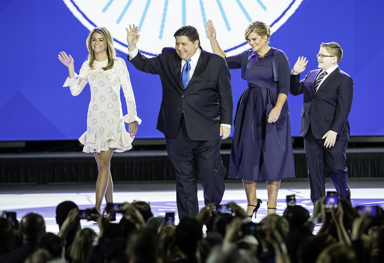 Governor-elect J.B. Pritzker and his family, daughter Teddi, wife M.K. and son Donny, take the stage during the Illinois Inaugural Ceremony at the Bank of Springfield Center Monday, Jan. 14, 2019. [Ted Schurter/The State Journal-Register]