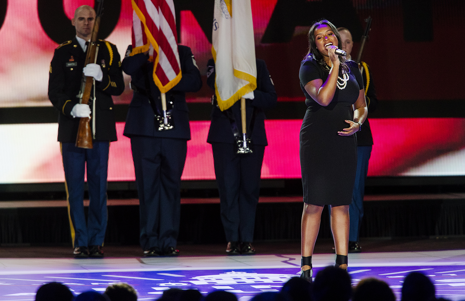"""Alexandria du Buclet performs """"Lift Ev'ry Voice and Sing"""" during the Illinois Inaugural Ceremony at the Bank of Springfield Center Monday, Jan. 14, 2019. [Ted Schurter/The State Journal-Register]"""