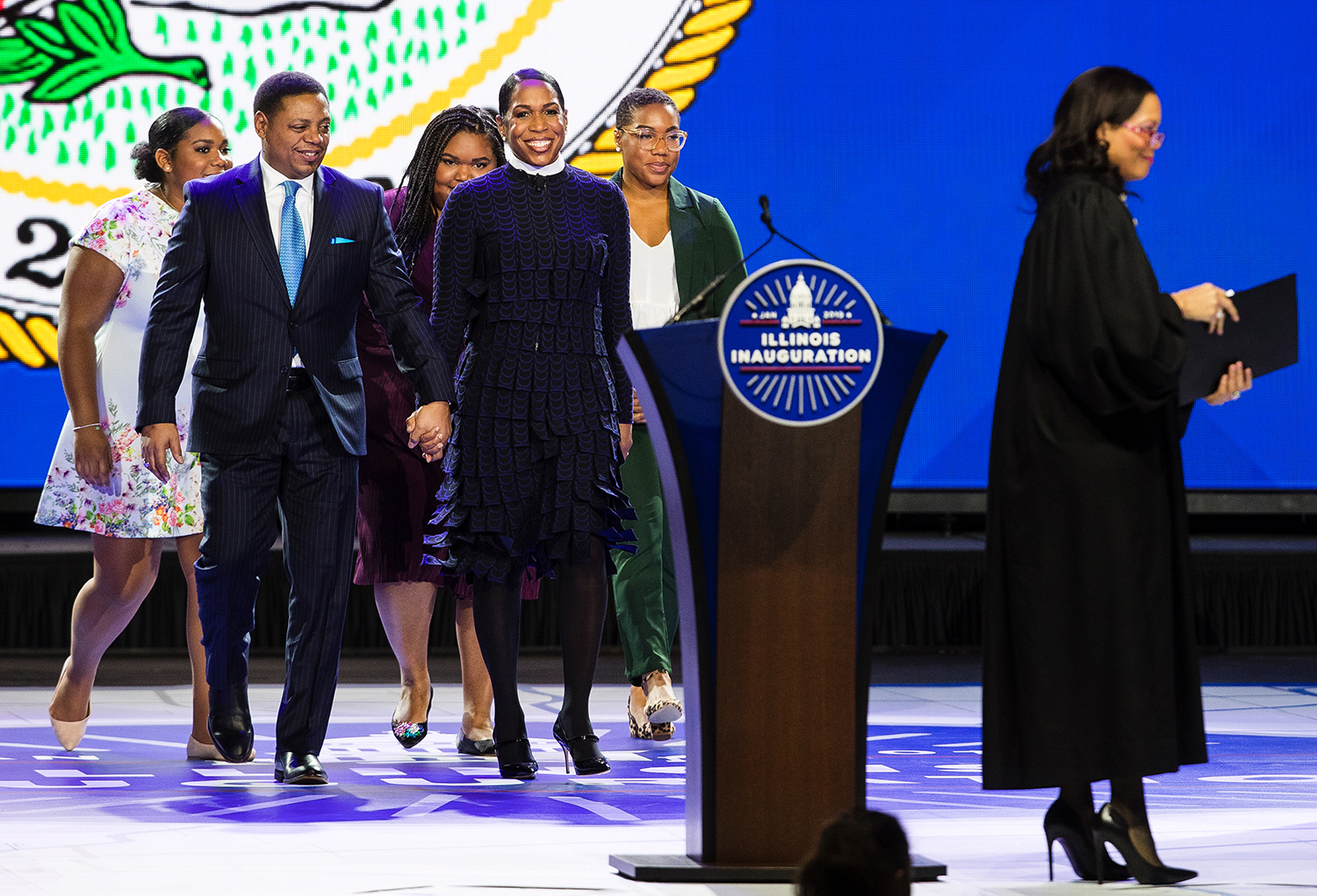 Lt. Gov.-elect Juliana Stratton takes the stage to take the oath of office with her fiance Bryan Echols and daughters Ryan, Tyler and Cassidy during the Illinois Inaugural Ceremony at the Bank of Springfield Center Monday, Jan. 14, 2019. [Ted Schurter/The State Journal-Register]
