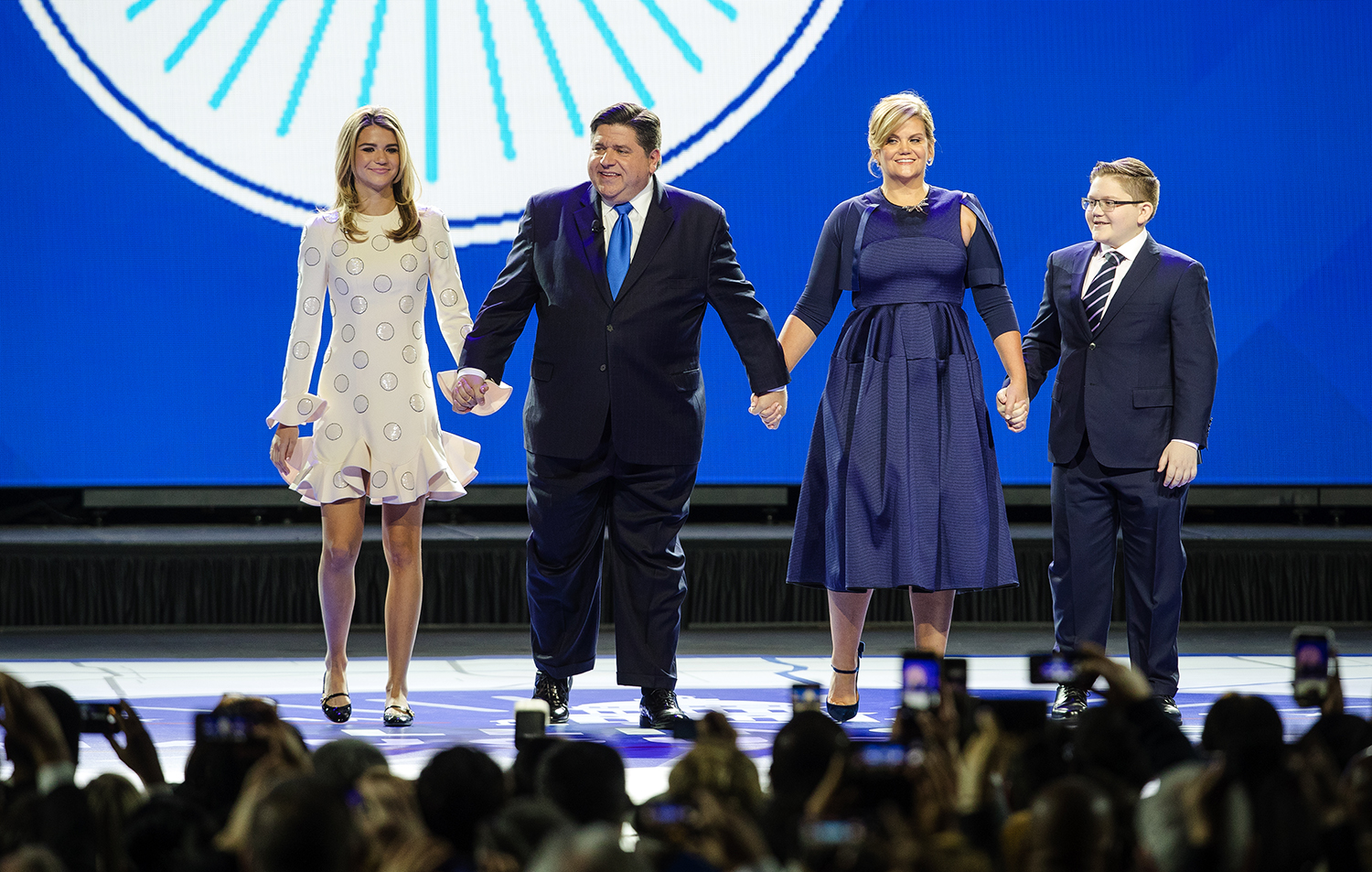 Teddi, left, Governor-elect J.B., M.K. and Donny Pritzker take the stage during the Illinois Inaugural Ceremony at the Bank of Springfield Center Monday, Jan. 14, 2019. [Ted Schurter/The State Journal-Register][Ted Schurter/The State Journal-Register]