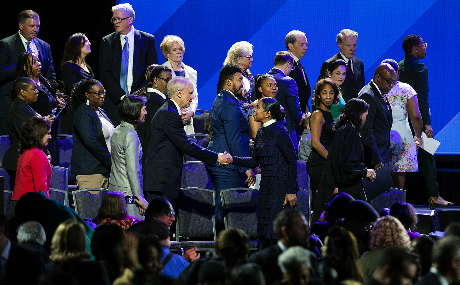 Lt. Gov. Juliana Stratton greets former Illinois Governor Bruce Rauner at the conclusion of the Illinois Inaugural Ceremony at the Bank of Springfield Center Monday, Jan. 14, 2019. [Ted Schurter/The State Journal-Register]
