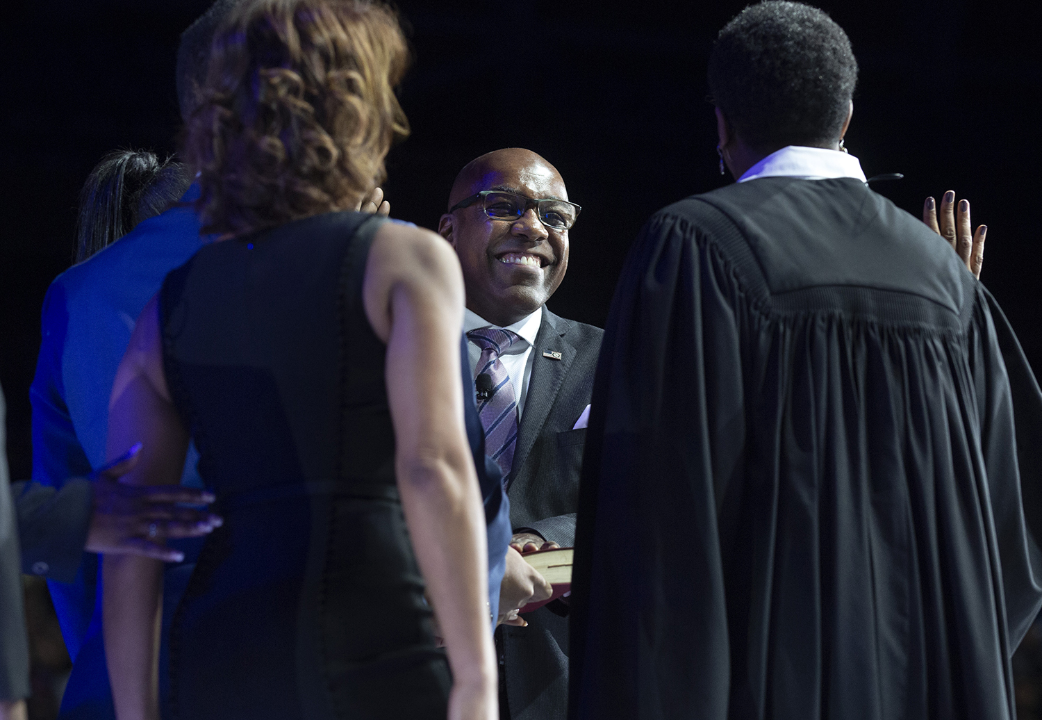 Attorney General Kwame Raoul wears a big smile just as he begins the oath of office administered by Judge Sharon Johnson Coleman during the Illinois Inaugural Ceremony Monday, Jan. 14, 2019 a the Bank of Springfield Center in Springfield, Ill. [Rich Saal/The State Journal-Register]