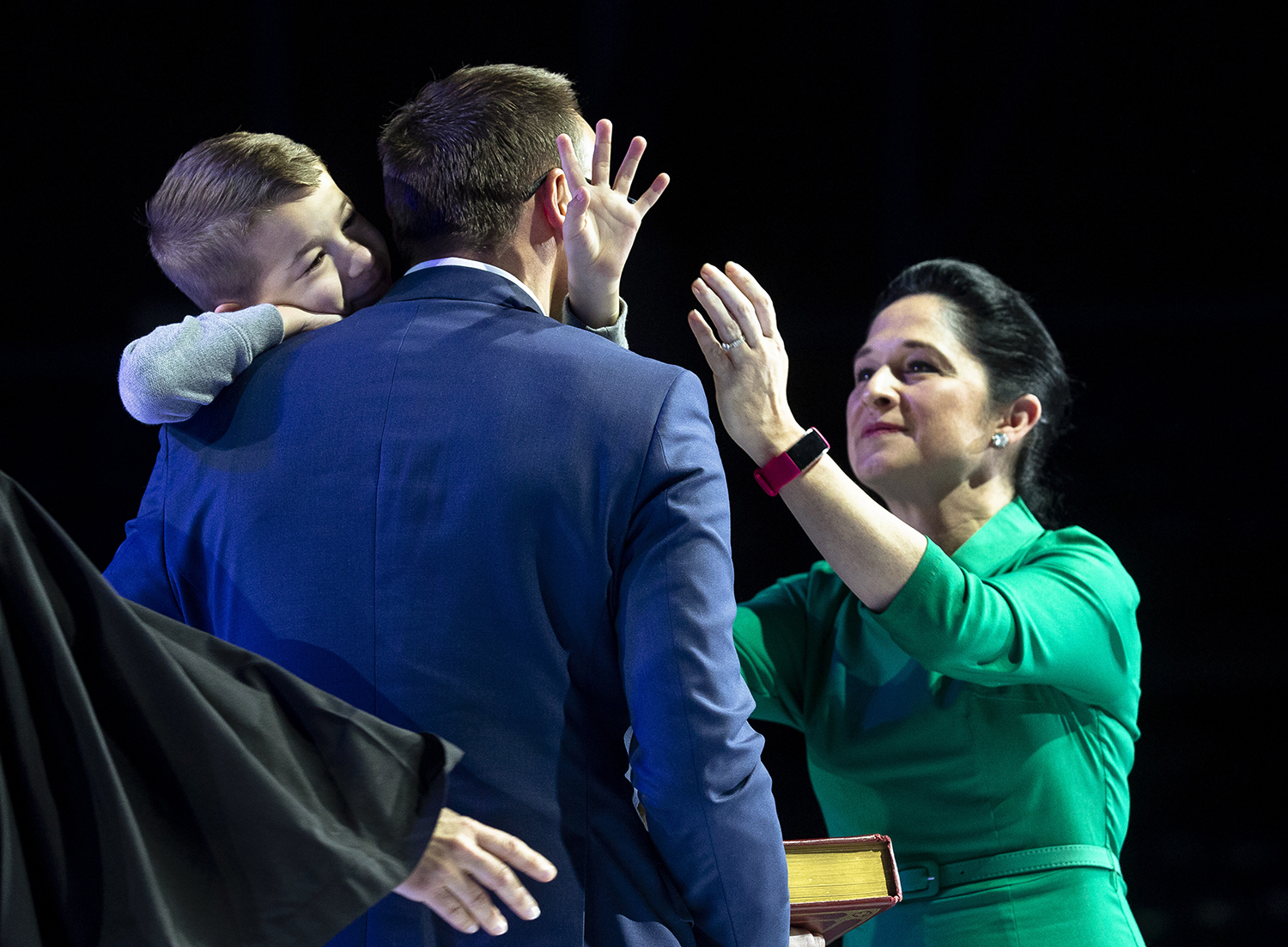 Comptroller Susana Mendoza reaches for her husband, David, who is holding their son, David, after she was sworn into office at the Illinois Inaugural Ceremony Monday, Jan. 14, 2019 a the Bank of Springfield Center in Springfield, Ill. [Rich Saal/The State Journal-Register]