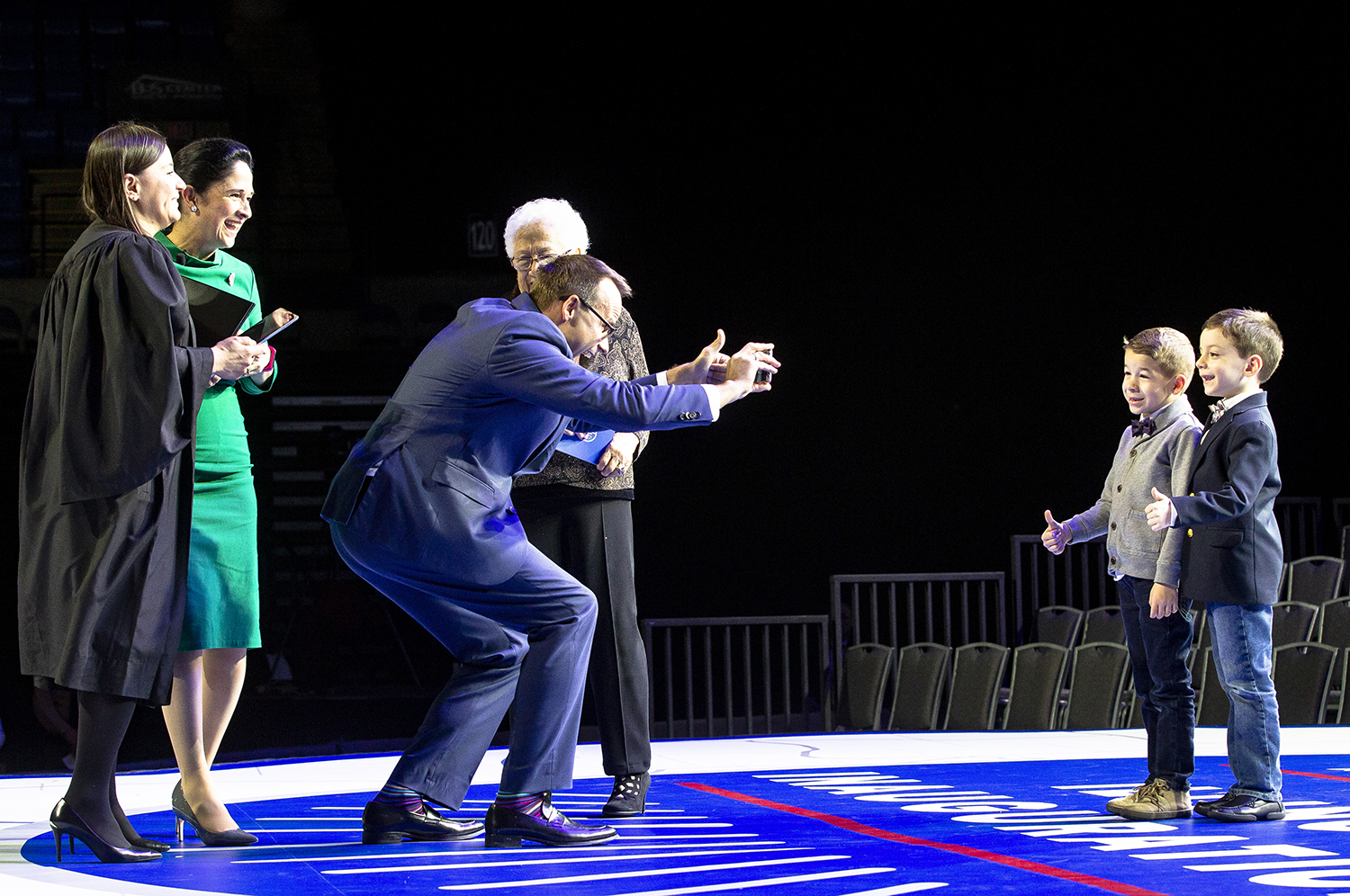 Judge Rosanna Fernandez, left, and Comptroller Susana Mendoza watch while Mendoza's husband, David Szostak, snaps a picture of their son, David and Fernandaz's son, Lucas, after the Illinois Inaugural Ceremony had ended Monday, Jan. 14, 2019 a the Bank of Springfield Center in Springfield, Ill. [Rich Saal/The State Journal-Register]