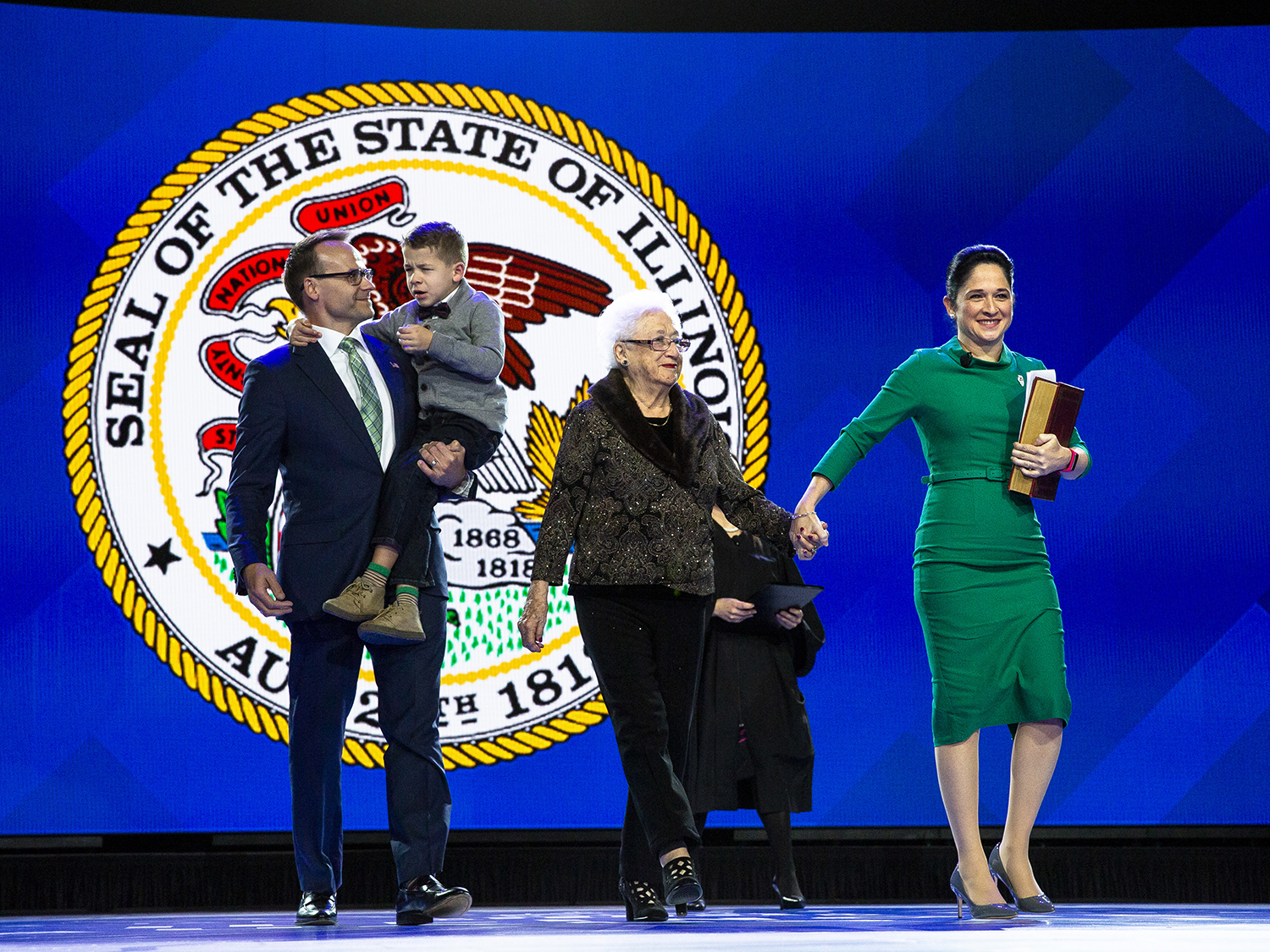 Comptroller Susana Mendoza walks onto the stage with her mother, Susana H. Mendoza, husband, David Szostak, and their son, David, before taking the oath at the Illinois Inaugural Ceremony Monday, Jan. 14, 2019 a the Bank of Springfield Center in Springfield, Ill. [Rich Saal/The State Journal-Register]