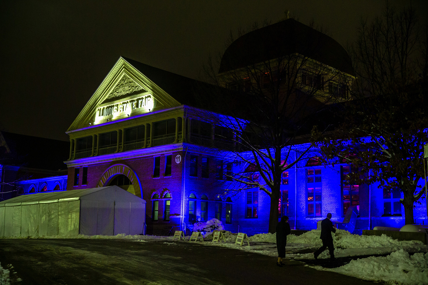 The Exposition Building is lit in blue for Gov. J.B. Pritzker's Inaugural Ball at the Illinois State Fairgrounds, Monday, Jan. 14, 2019, in Springfield, Ill. [Justin L. Fowler/The State Journal-Register]