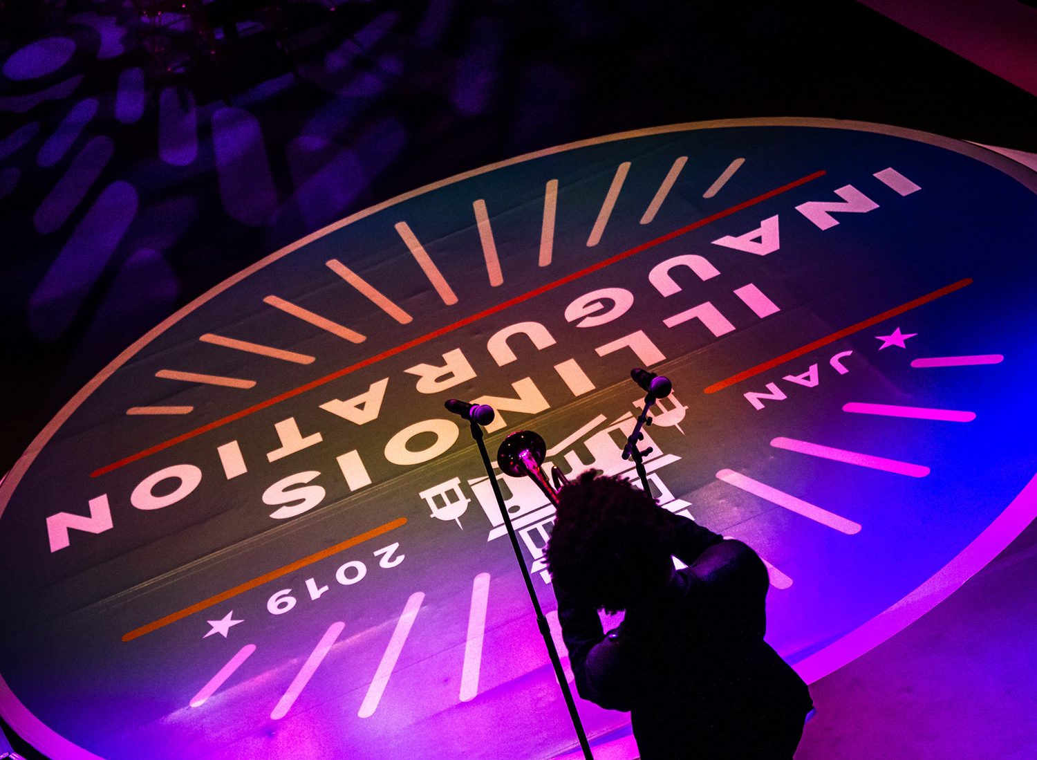 The opening band sets the stage for Gov. J.B. Pritzker's Inaugural Ball at the Exposition Building on the Illinois State Fairgrounds, Monday, Jan. 14, 2019, in Springfield, Ill. [Justin L. Fowler/The State Journal-Register]