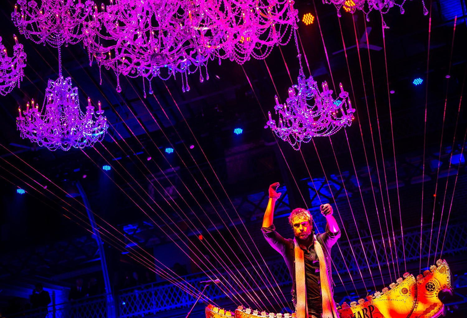 William Close performs on his Earth Harp Ensemble built into the structure of the Exposition Building during Gov. J.B. Pritzker's Inaugural Ball at the Exposition Building on the Illinois State Fairgrounds, Monday, Jan. 14, 2019, in Springfield, Ill. [Justin L. Fowler/The State Journal-Register]