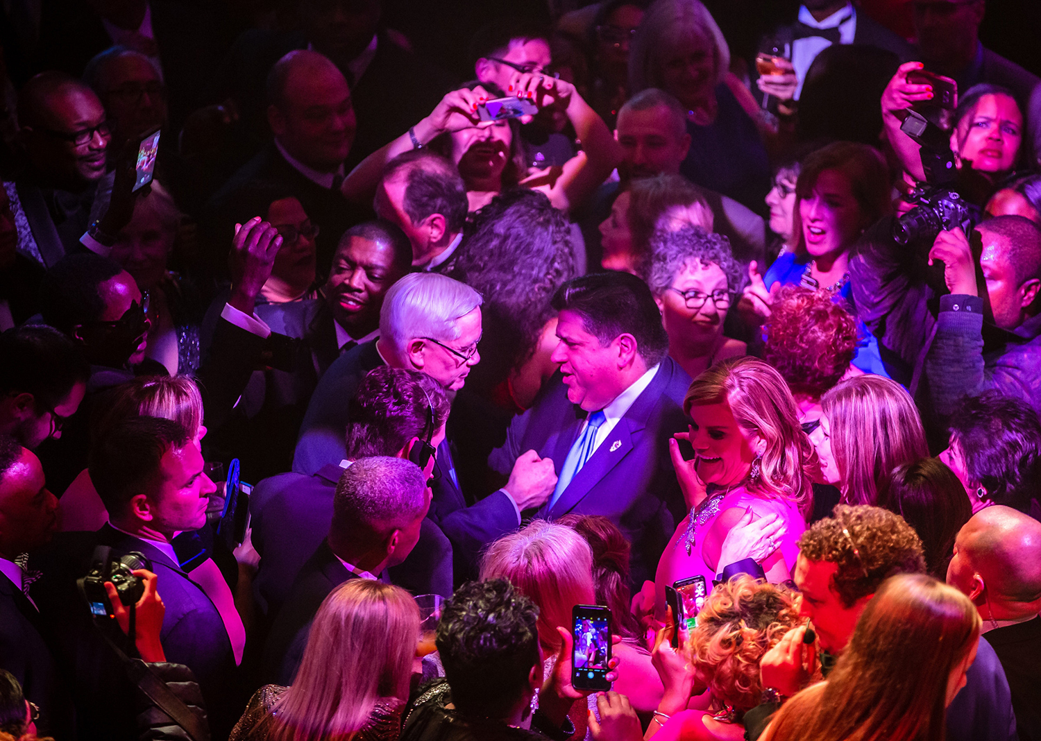 Gov. J.B. Pritzker talks with Bill Houlihan as he makes his way out into the crowd with his wife M.K. Pritzker after their first dance at the Inaugural Ball at the Exposition Building on the Illinois State Fairgrounds, Monday, Jan. 14, 2019, in Springfield, Ill. [Justin L. Fowler/The State Journal-Register]