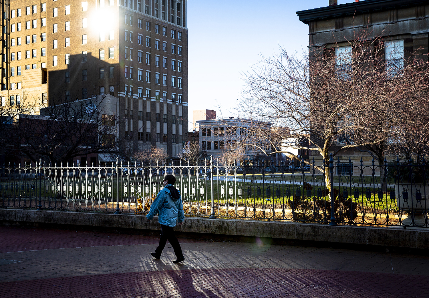Brilliant sunshine on the Old Capitol Plaza and a temperature that reached 60 degrees made a January day feel briefly like spring for people who were able to get outside Monday, Jan. 7, 2019 in Springfield, Ill. Wednesday is a different story, however, when the high temperature isn't expected to break freezing. [Rich Saal/The State Journal-Register]
