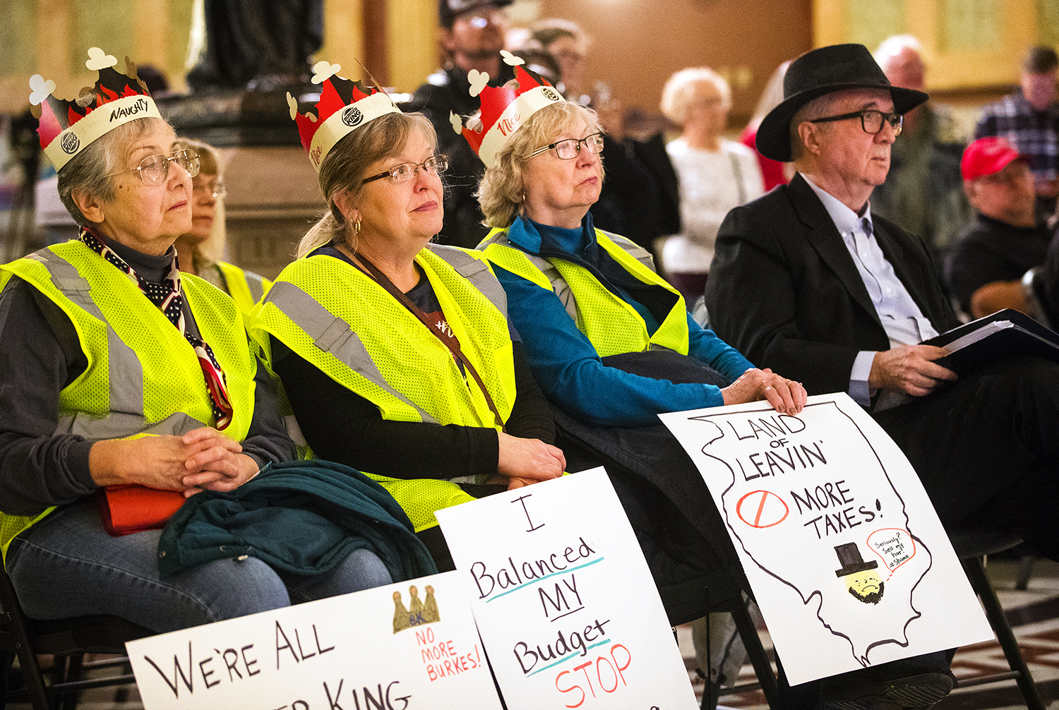 Lora Landrum, left, Joni Sorce and Margie Kreier listen to Illinois State Rep. Allen Skillicorn, (R-East Dundee), during an event in the Capitol rotunda Monday, Jan. 7, 2019. Skillicorn and other speakers voiced their opposition to the passage of any new taxes by a lame duck legislature. [Ted Schurter/The State Journal-Register]