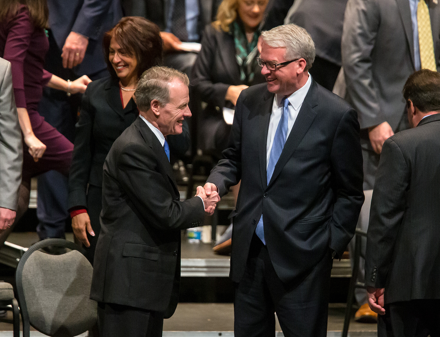 Illinois Speaker of the House Michael Madigan, D-Chicago, shakes hands with Illinois House Minority Leader Jim Durkin, R-Western Springs, prior to the inauguration ceremony for the Illinois House of Representatives for the 101st General Assembly at the University of Illinois Springfield's Sangamon Auditorium, Wednesday, Jan. 9, 2019, in Springfield, Ill. [Justin L. Fowler/The State Journal-Register]