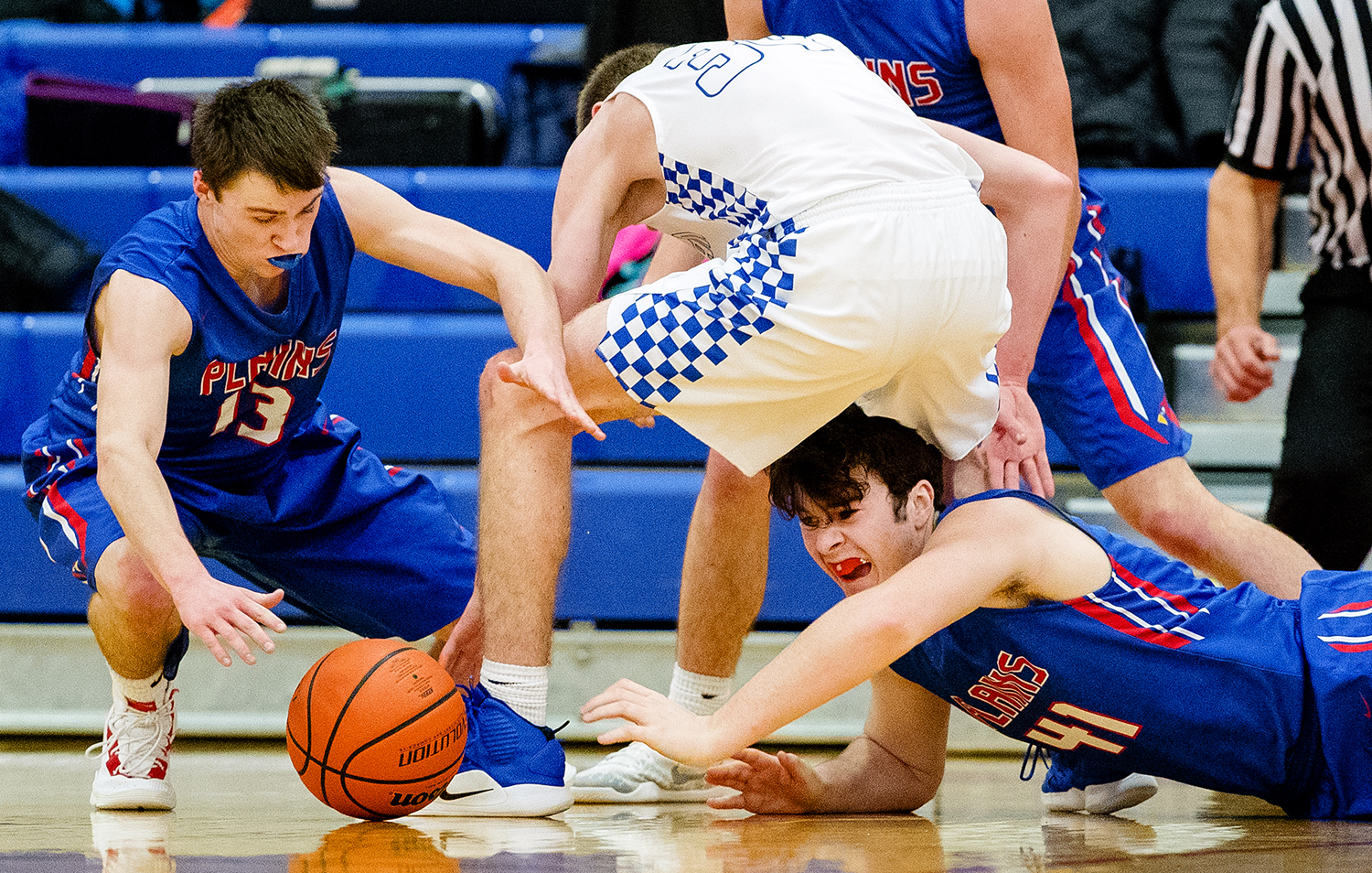 Pleasant Plains' Corgan Greer, left, Lutheran's Hank Hayer and Pleasant Plains' Chase Schmitt dive for a loose ball during the Sangamon County High School Basketball Tournament at Lincoln Land Community College Thursday, Jan. 10, 2019. [Ted Schurter/The State Journal-Register]