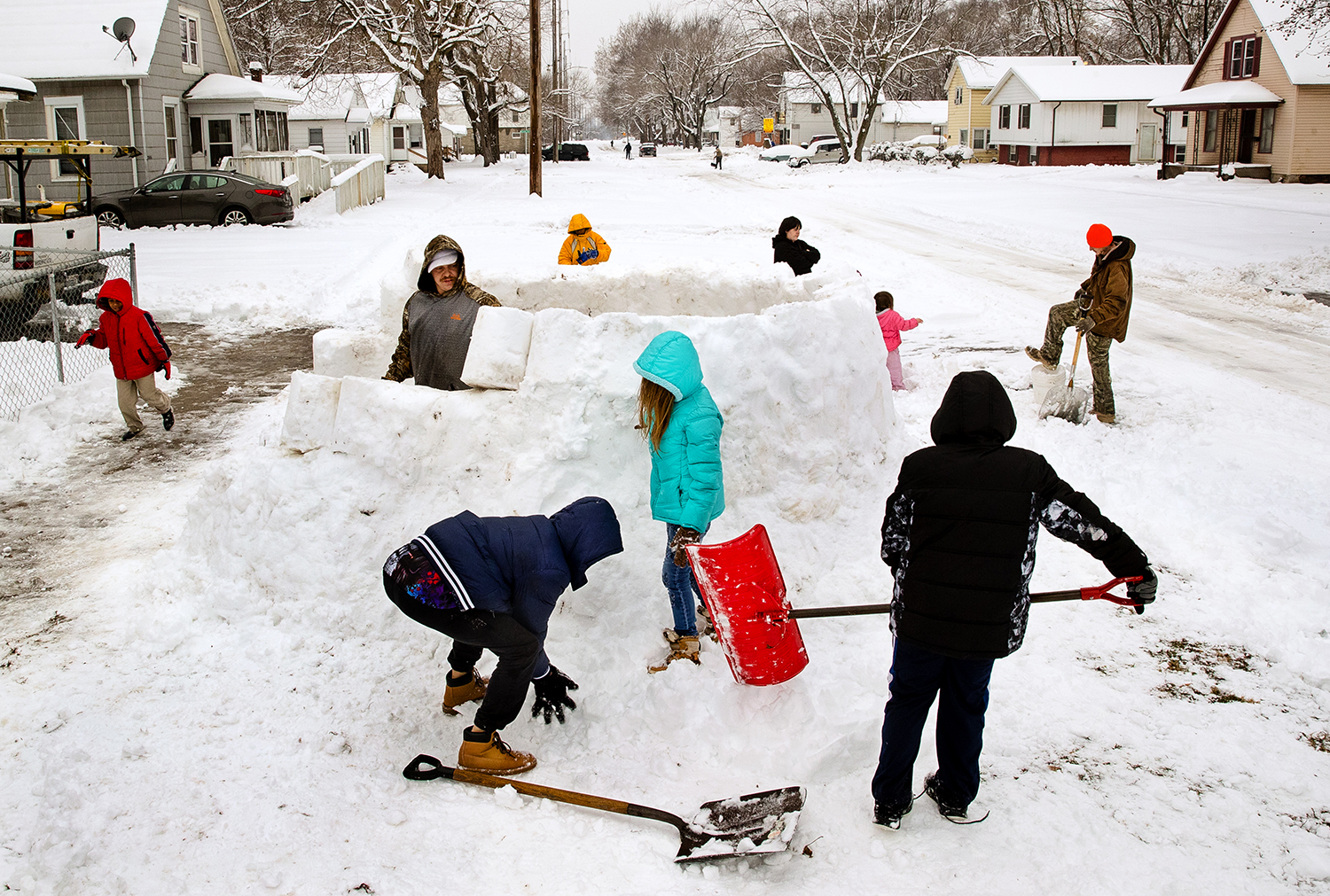 """Michael Motley had the help of his children, friends and neighbors as he built giant igloo in the front yard of his Springfield home Saturday, Jan. 12, 2019. """"This is what we did when I was a kid,"""" Motley said. [Ted Schurter/The State Journal-Register]"""
