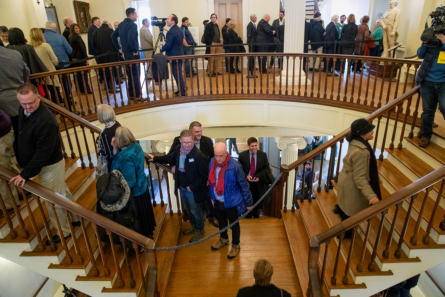 Guests queue up in the stairwell at the Old State Capitol to greet Governor-elect J.B. Pritzker during an open house Sunday, Jan. 13, 2019. [Ted Schurter/The State Journal-Register]