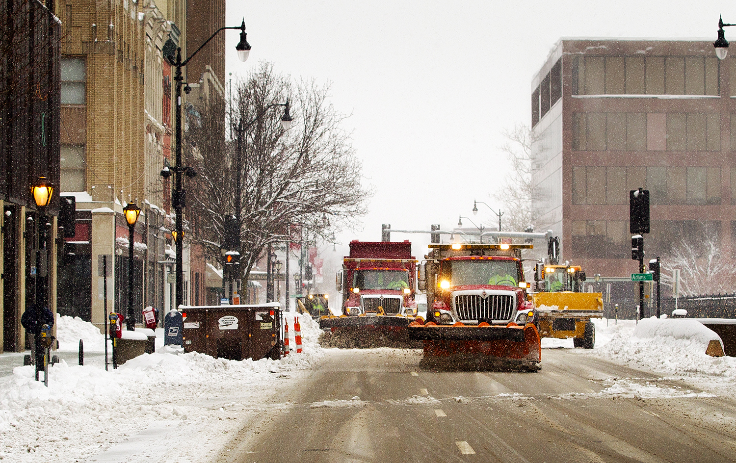 City workers plow the streets in downtown Springfield as snow continues to fall Sunday, Jan. 13, 2019. [Ted Schurter/The State Journal-Register]