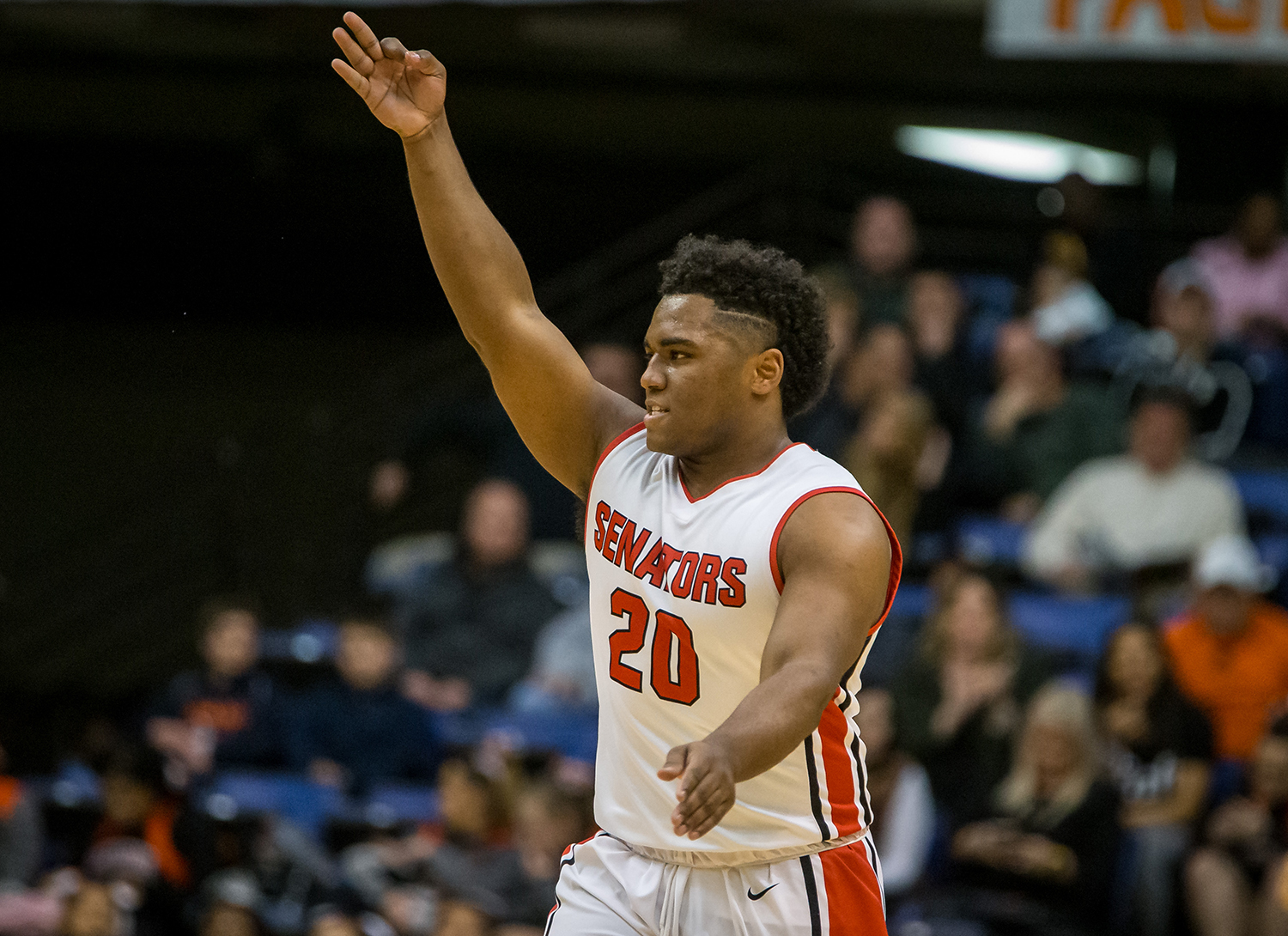 Springfield's Caleb Small (20) reacts after draining a 3-pointer against Sacred Heart-Griffin in the second quarter on opening night of the Boys City Tournament at the Bank of Springfield Center, Wednesday, Jan. 16, 2019, in Springfield, Ill. [Justin L. Fowler/The State Journal-Register]