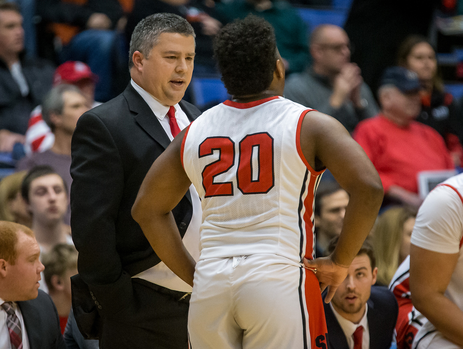 Springfield boys basketball head coach Joby Crum talks with Springfield's Caleb Small (20) as the Senators take on Sacred Heart-Griffin in the second quarter on opening night of the Boys City Tournament at the Bank of Springfield Center, Wednesday, Jan. 16, 2019, in Springfield, Ill. [Justin L. Fowler/The State Journal-Register]