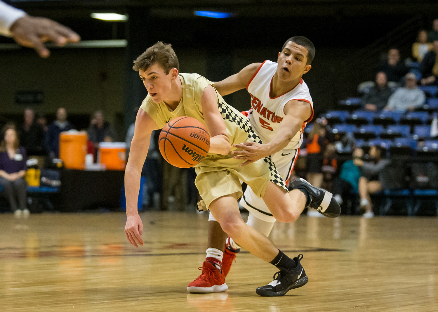 Sacred Heart-Griffin's Jack Thoma (22) dribbles around the pressure from Springfield's Shane Miller (5) in the second quarter on opening night of the Boys City Tournament at the Bank of Springfield Center, Wednesday, Jan. 16, 2019, in Springfield, Ill. [Justin L. Fowler/The State Journal-Register]