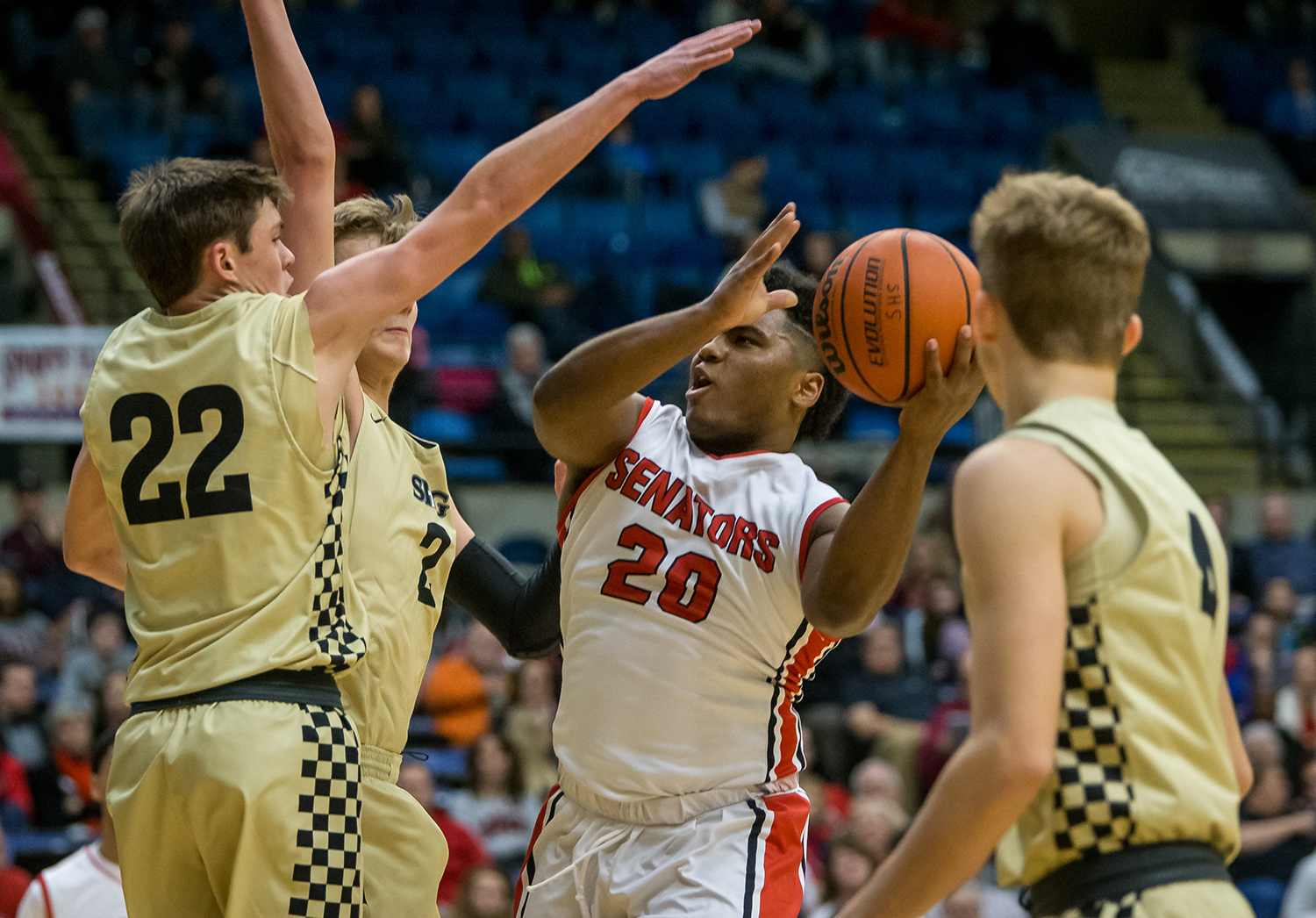 Springfield's Caleb Small (20) drives into the basket against a trio Sacred Heart-Griffin defenders in the third quarter on opening night of the Boys City Tournament at the Bank of Springfield Center, Wednesday, Jan. 16, 2019, in Springfield, Ill. [Justin L. Fowler/The State Journal-Register]