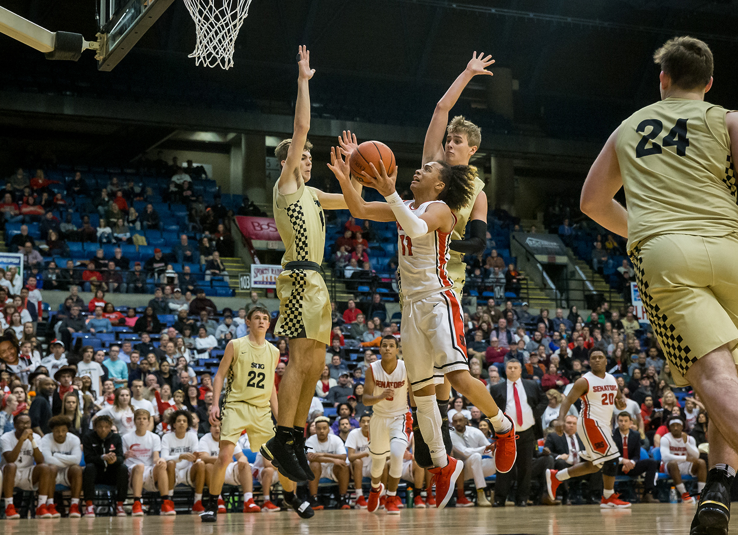 Springfield's Zaire Harris (11) drives up to the basket against Sacred Heart-Griffin's Joe Gustafson (2) and Sacred Heart-Griffin's Charlie Hamilton (4) in the fourth quarter on opening night of the Boys City Tournament at the Bank of Springfield Center, Wednesday, Jan. 16, 2019, in Springfield, Ill. [Justin L. Fowler/The State Journal-Register]