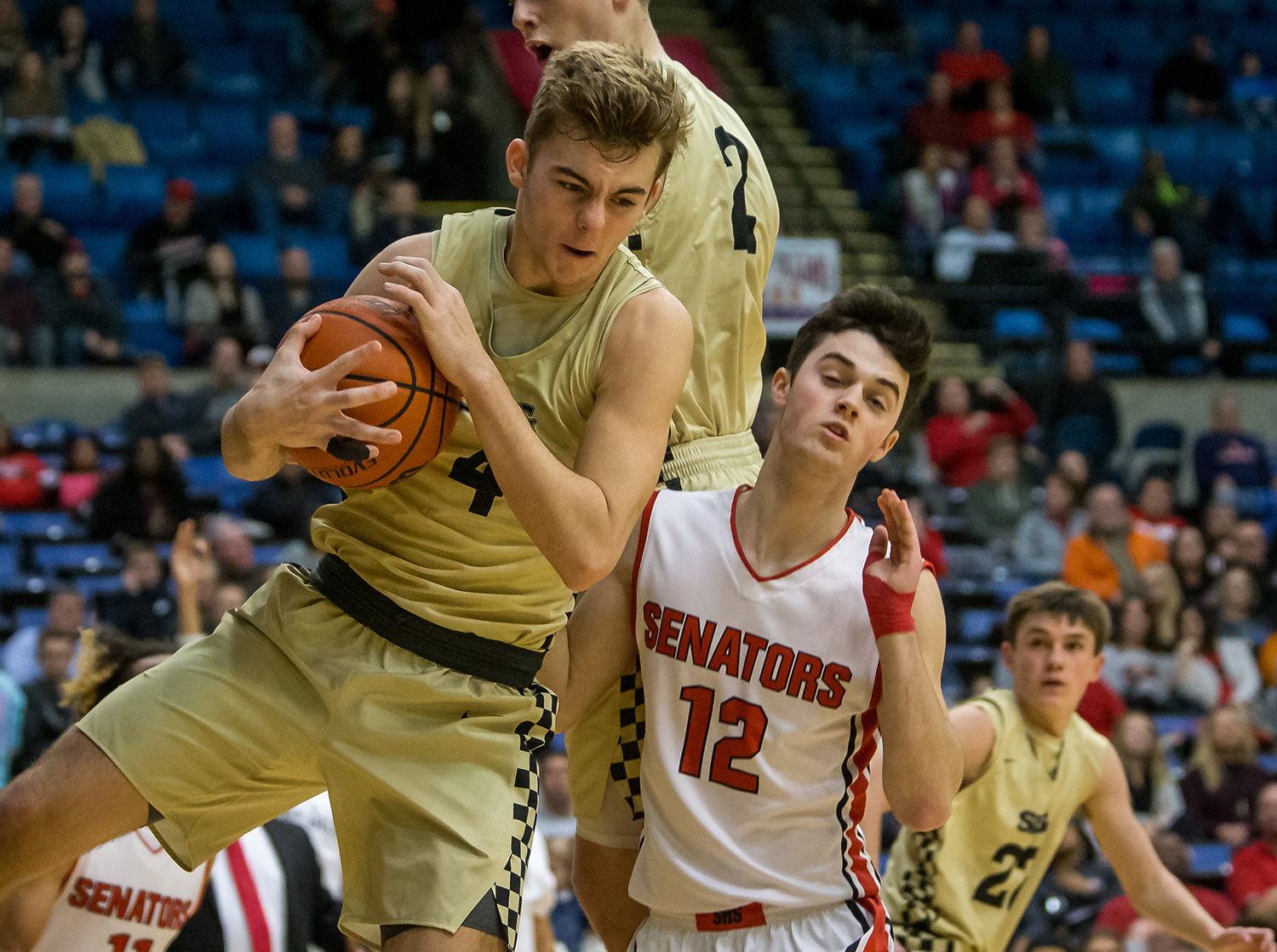 Sacred Heart-Griffin's Charlie Hamilton (4) pulls in a rebound against Springfield's Kobe Slater (12) in the fourth quarter on opening night of the Boys City Tournament at the Bank of Springfield Center, Wednesday, Jan. 16, 2019, in Springfield, Ill. [Justin L. Fowler/The State Journal-Register]