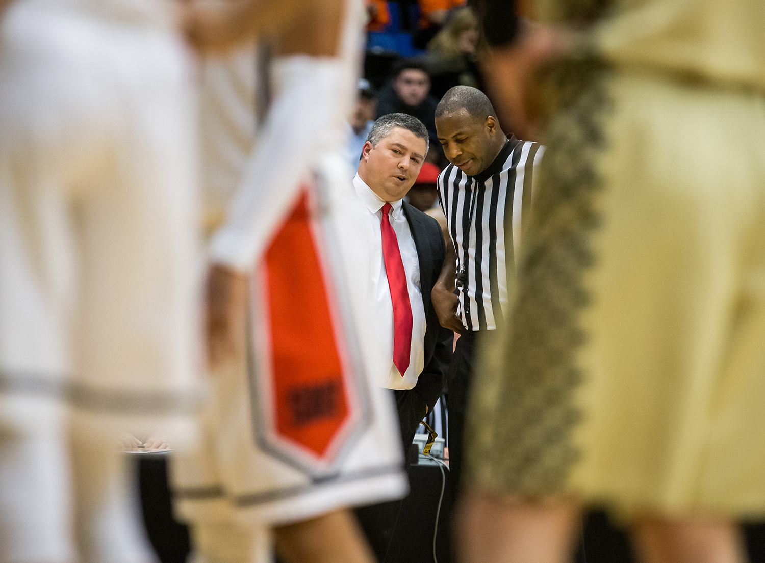 Springfield boys basketball head coach Joby Crum talks with a referee after a technical foul was called on both a Springfield and Sacred Heart-Griffin player in the fourth quarter on opening night of the Boys City Tournament at the Bank of Springfield Center, Wednesday, Jan. 16, 2019, in Springfield, Ill. [Justin L. Fowler/The State Journal-Register]