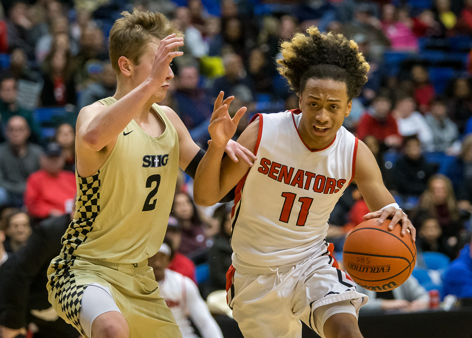 Springfield's Zaire Harris (11) drives in to the basket against Sacred Heart-Griffin's Joe Gustafson (2) in the fourth quarter on opening night of the Boys City Tournament at the Bank of Springfield Center, Wednesday, Jan. 16, 2019, in Springfield, Ill. [Justin L. Fowler/The State Journal-Register]