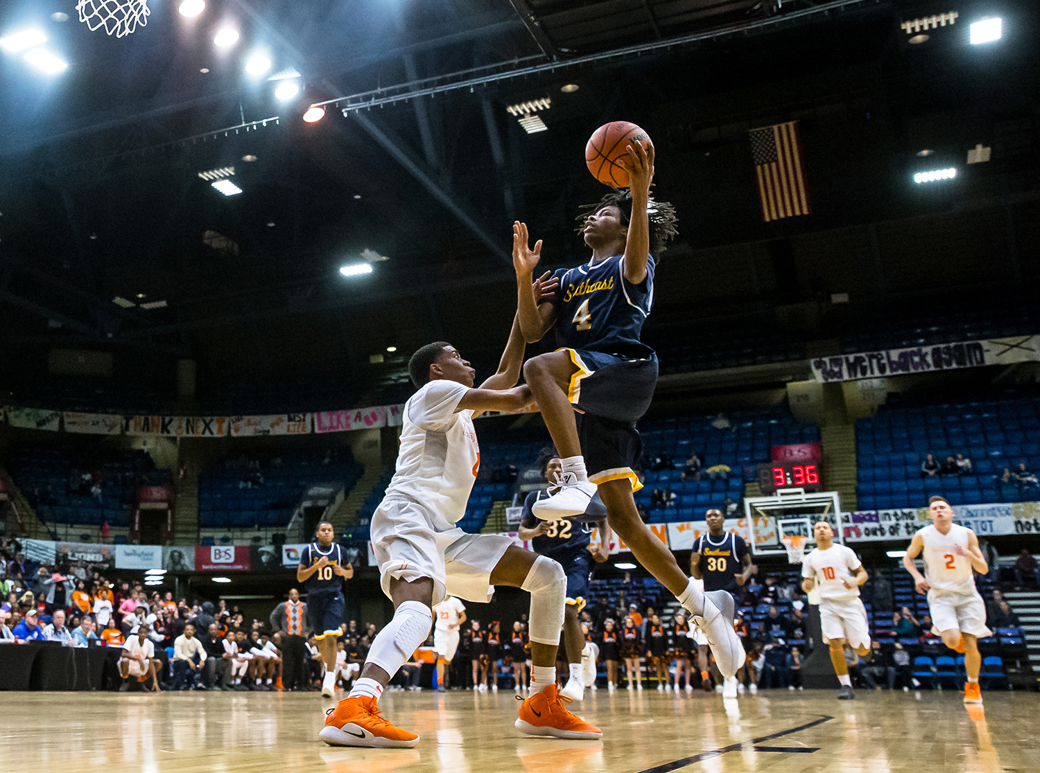 Southeast's Terrion Murdix (4) flies up to the basket against Lanphier's Larry Hemingway (4) in the fourth quarter on opening night of the Boys City Tournament at the Bank of Springfield Center, Wednesday, Jan. 16, 2019, in Springfield, Ill. [Justin L. Fowler/The State Journal-Register]
