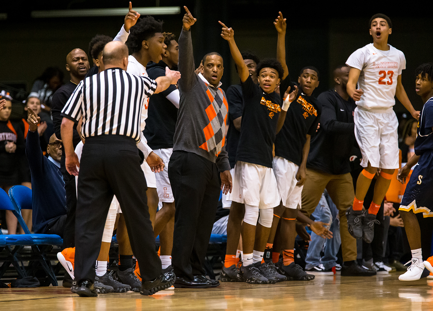 Lanphier boys basketball head coach Blake Turner and the Lions bench call out for a Lanphier ball that went out-of-bounds against Southeast in the first quarter on opening night of the Boys City Tournament at the Bank of Springfield Center, Wednesday, Jan. 16, 2019, in Springfield, Ill. [Justin L. Fowler/The State Journal-Register]