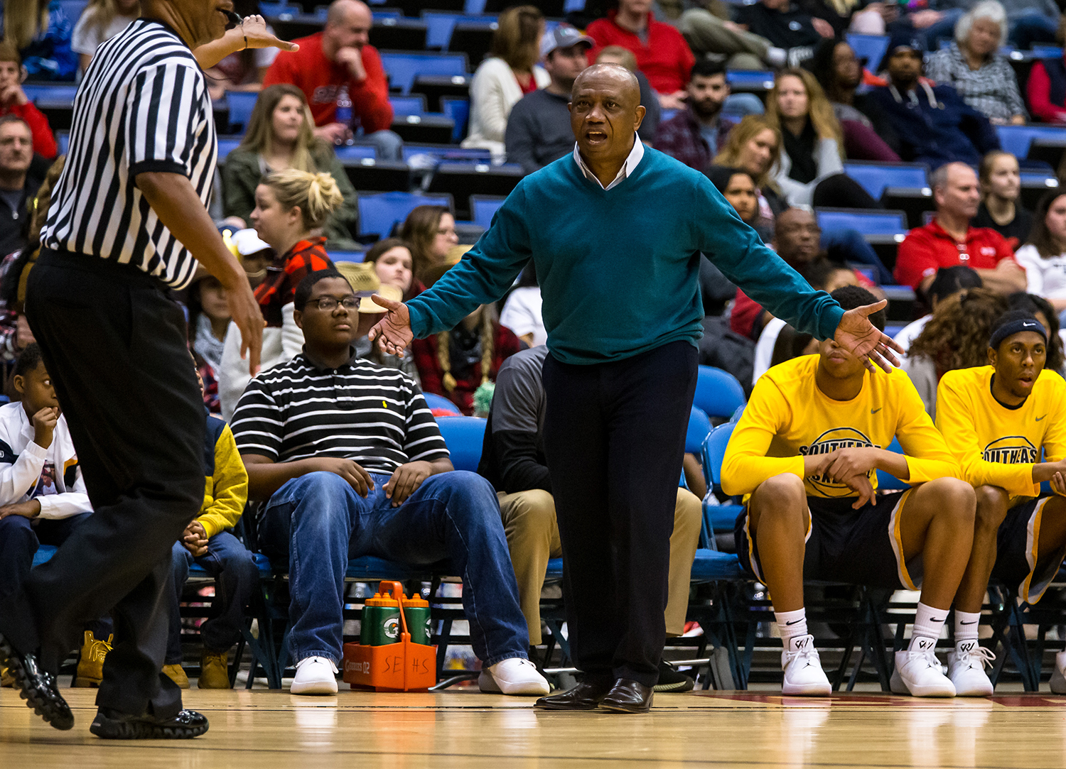 Southeast boys basketball head coach Lawrence Thomas calls out for a foul call against Lanphier as the Spartans take on the Lions in the second quarter on opening night of the Boys City Tournament at the Bank of Springfield Center, Wednesday, Jan. 16, 2019, in Springfield, Ill. [Justin L. Fowler/The State Journal-Register]