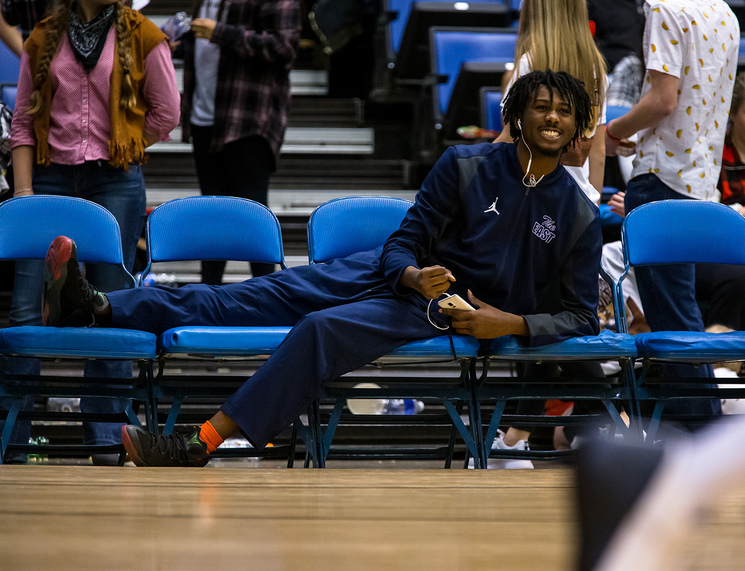 Southeast's Anthony Fairlee (21) watches from the bench as the Spartans take on Lanphier as he nurses his injured knee in the second quarter on opening night of the Boys City Tournament at the Bank of Springfield Center, Wednesday, Jan. 16, 2019, in Springfield, Ill. [Justin L. Fowler/The State Journal-Register]